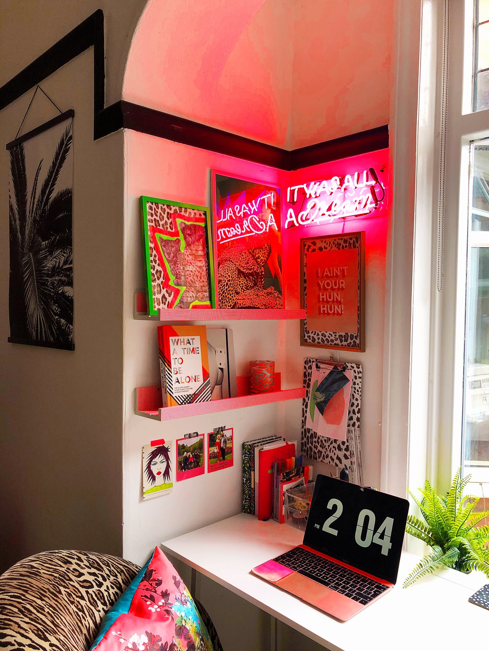 RHOI colourful desk set up with pink neon sign and animal print chair