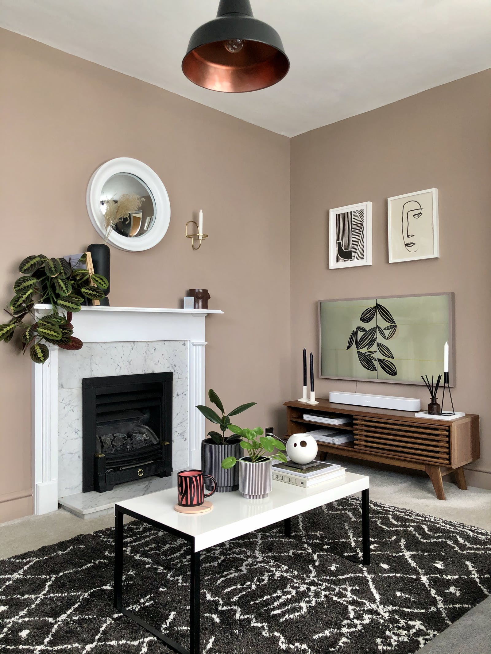 Living room with beige walls and marble fireplace