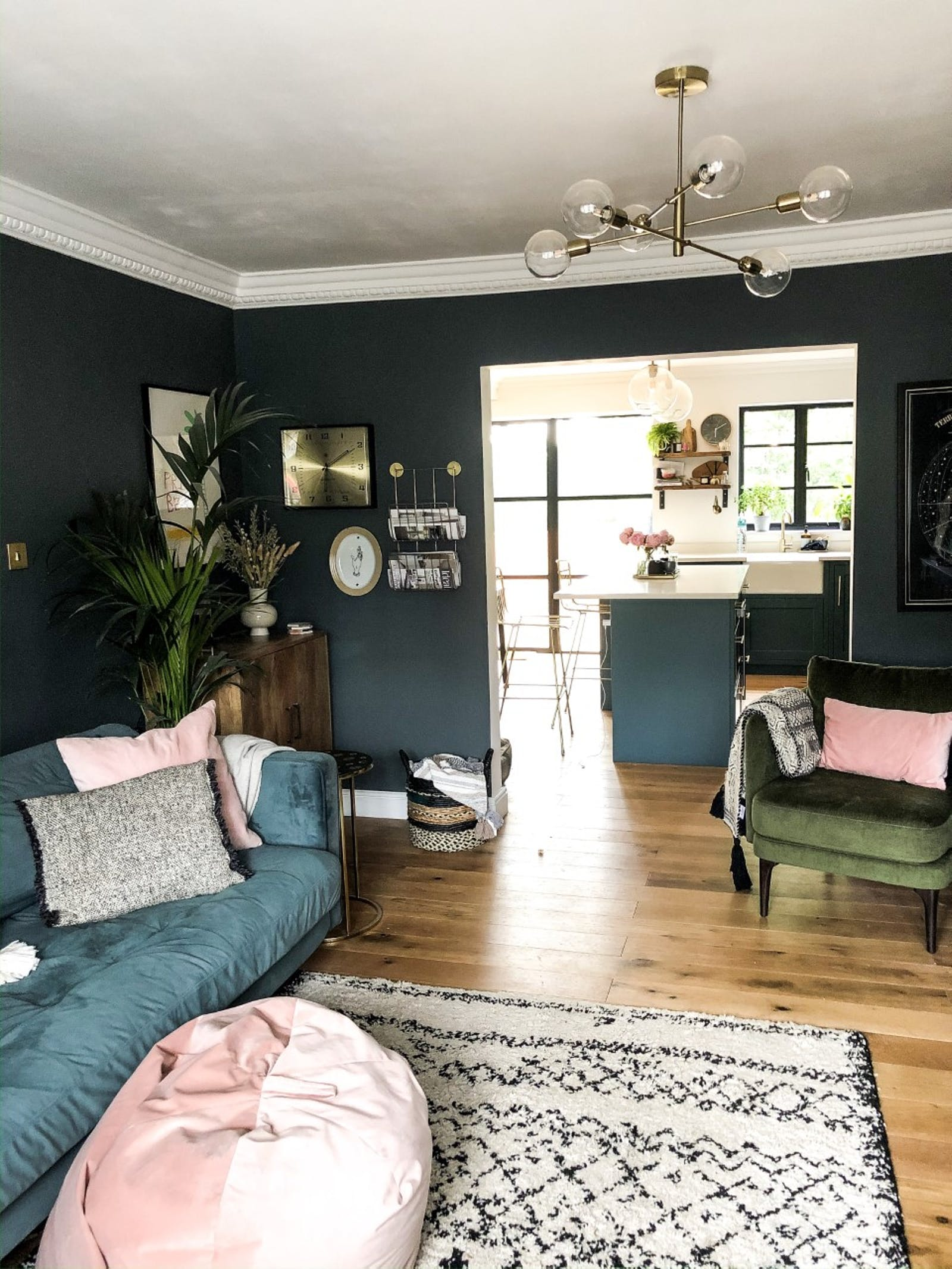 Living room painted in a dark teal colour
