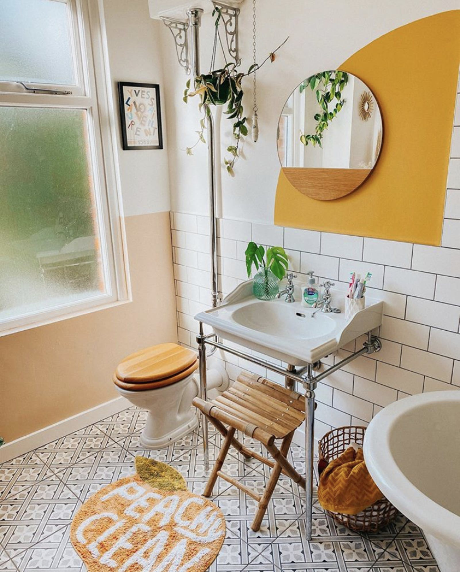 Bathroom with greenery and yellow accent wall detail