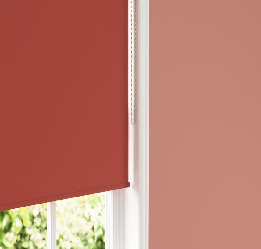 Close up of Lick Red 02 roller blind against Lick Red 01 wall