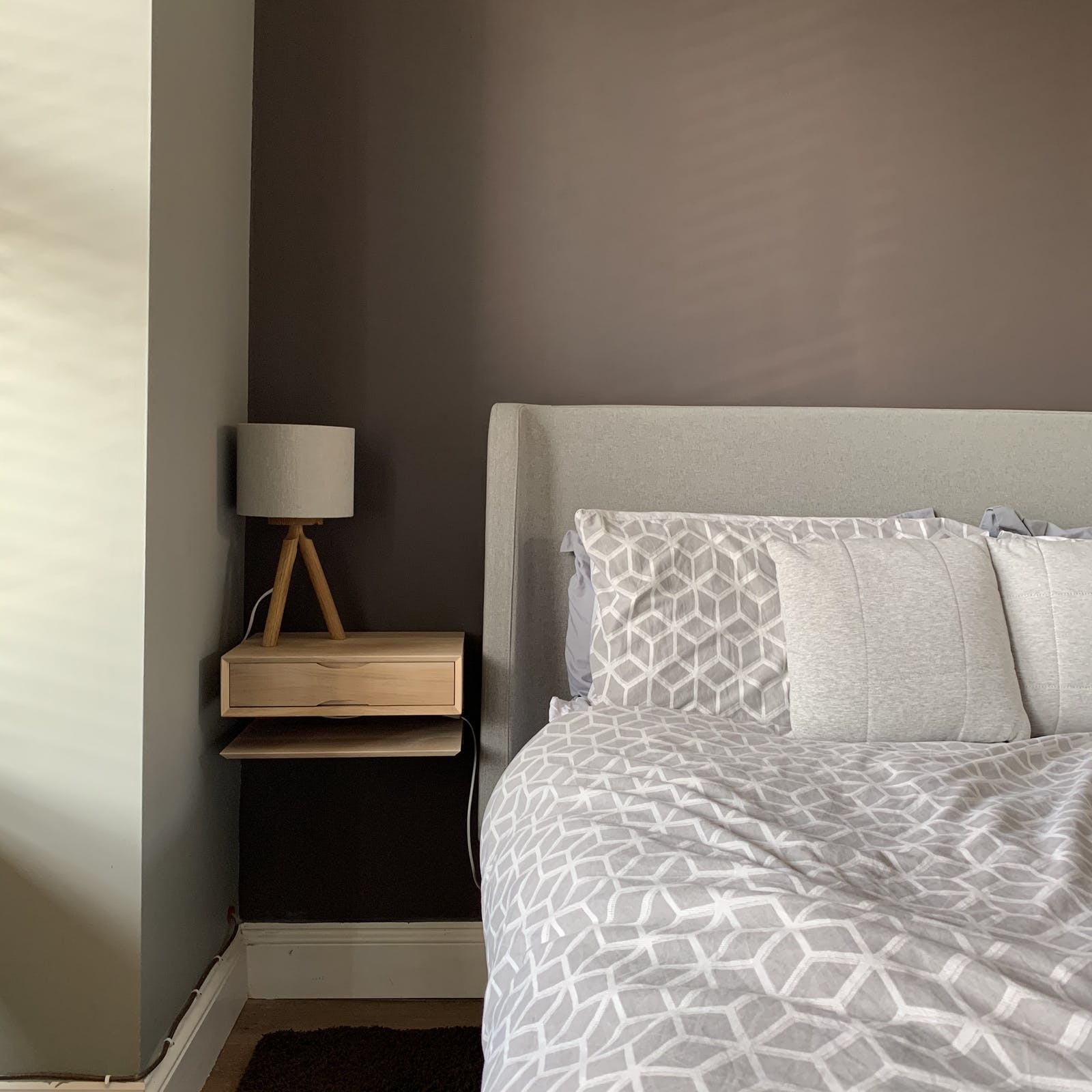 Neutral bedroom with floating nightstand and Lick Brown 01 walls