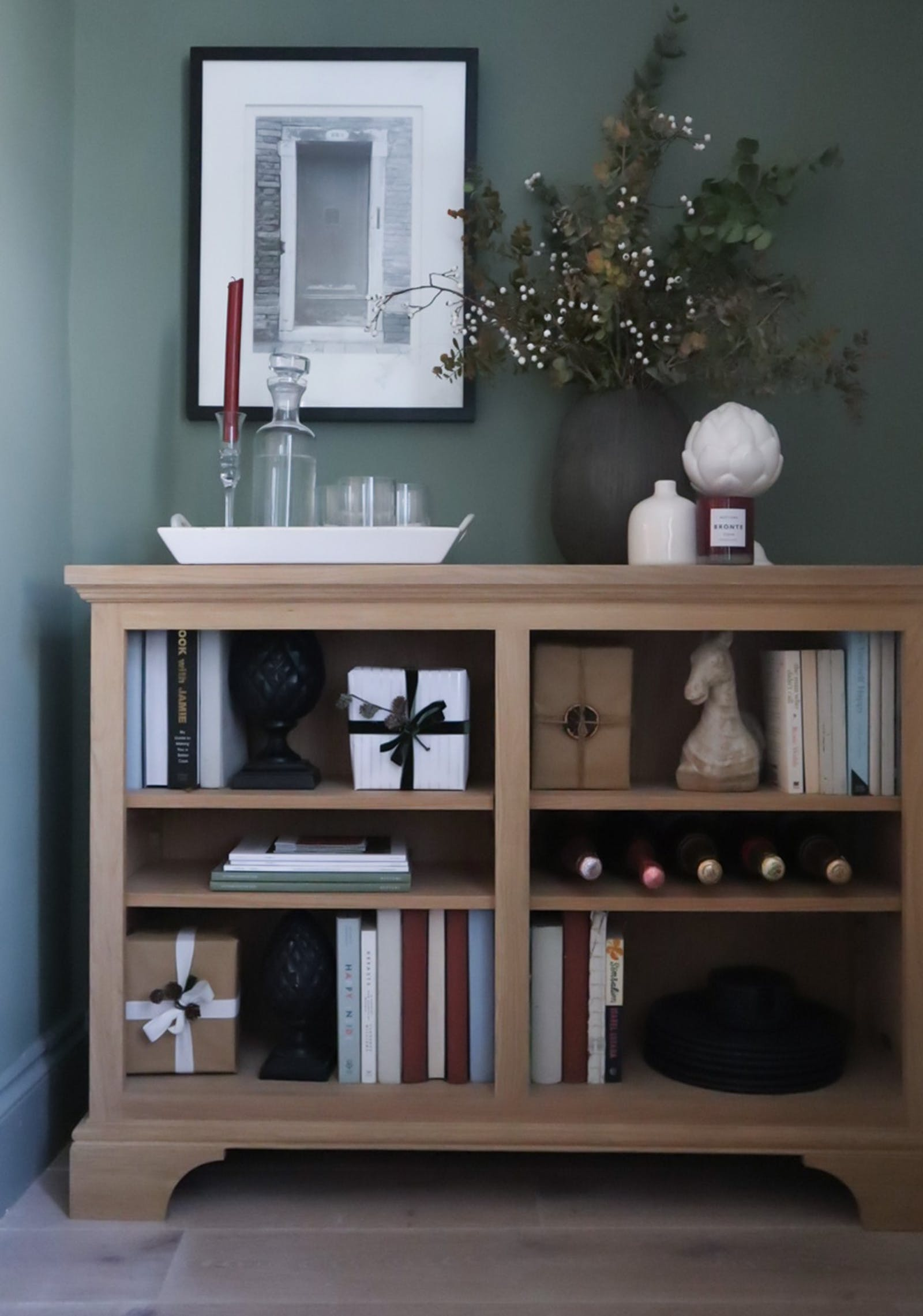 Display bookcase with Christmas presents and candle decorations