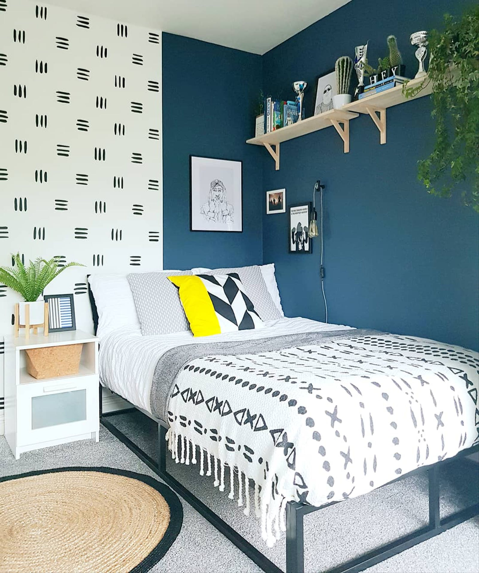 Bedroom with grey carpeted floor and walls painted in Lick Blue 07