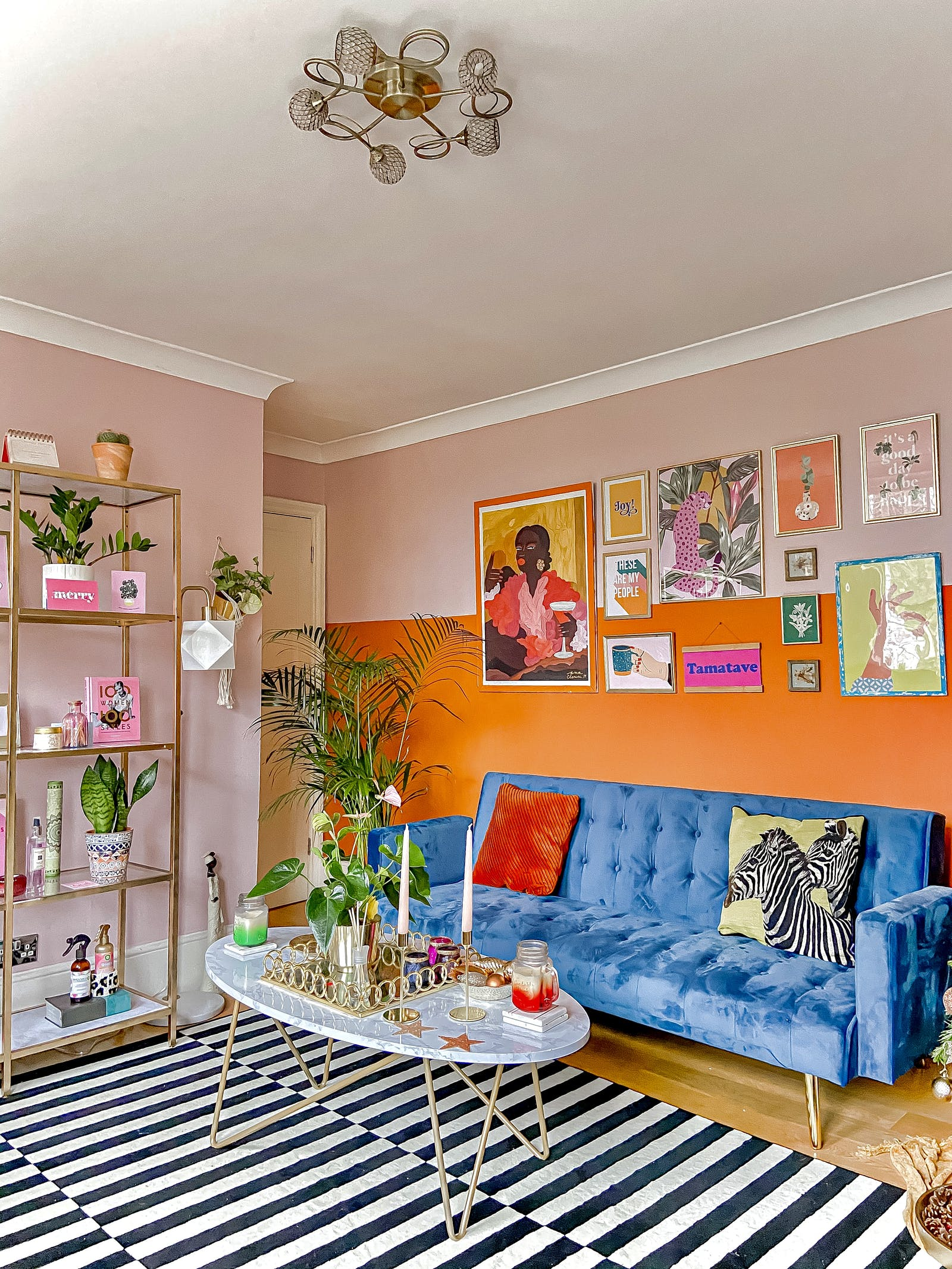 Brightly coloured living room with walls colour blocked in orange and Lick Pink 03 paint