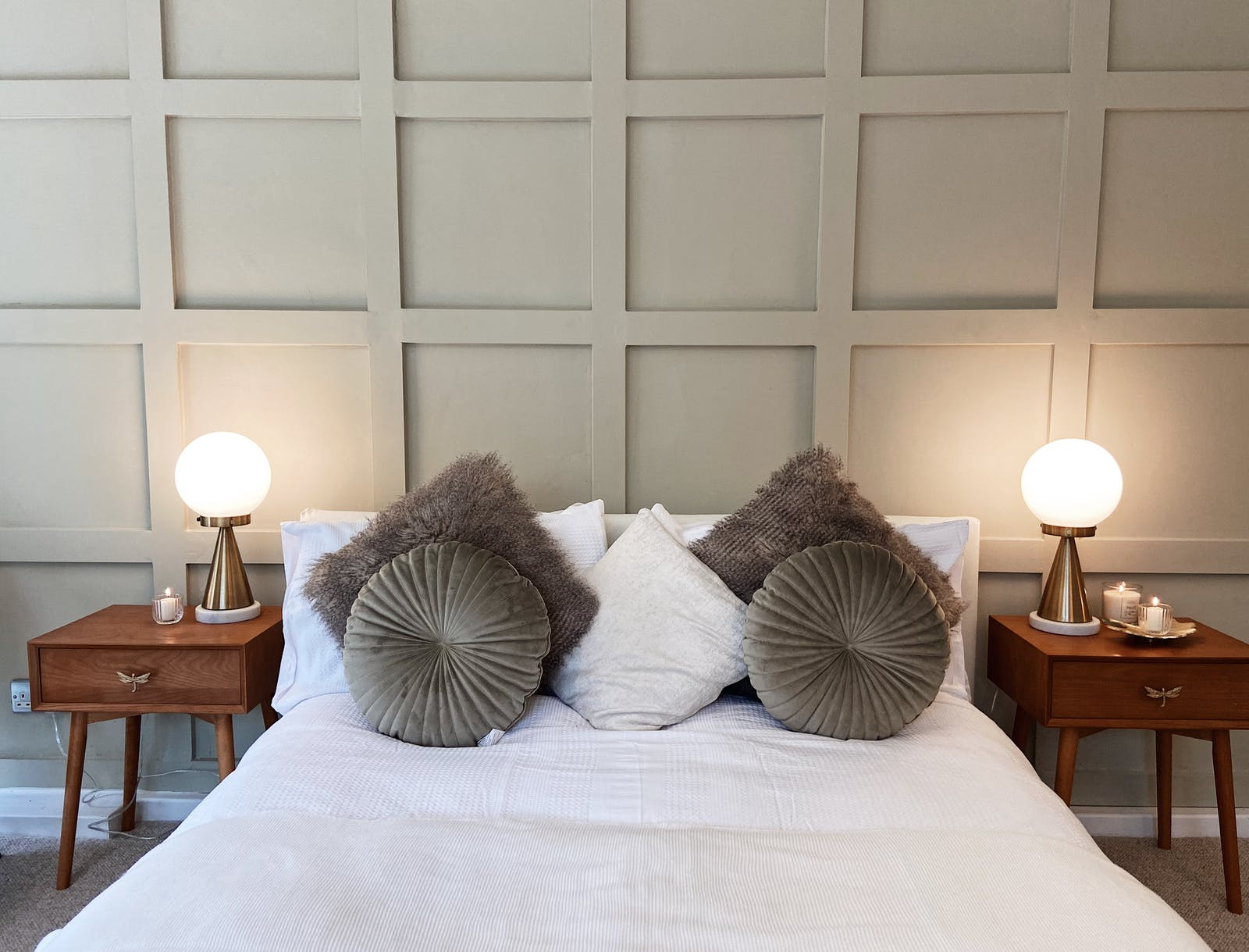 DAOB close up of krystal's panelling headboard with symmetrical pillow arrangement on bed