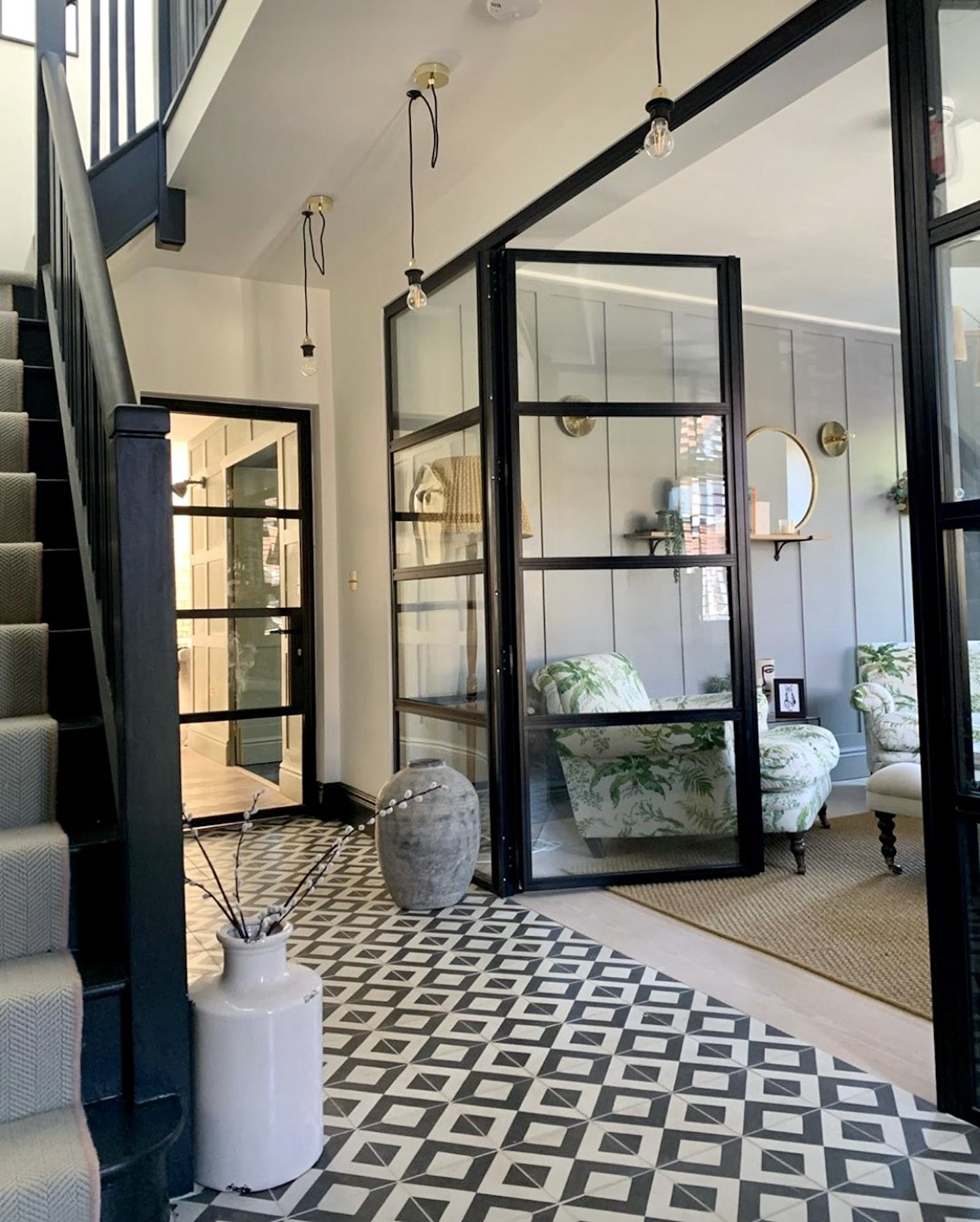 Hallway with tiles and glass doors