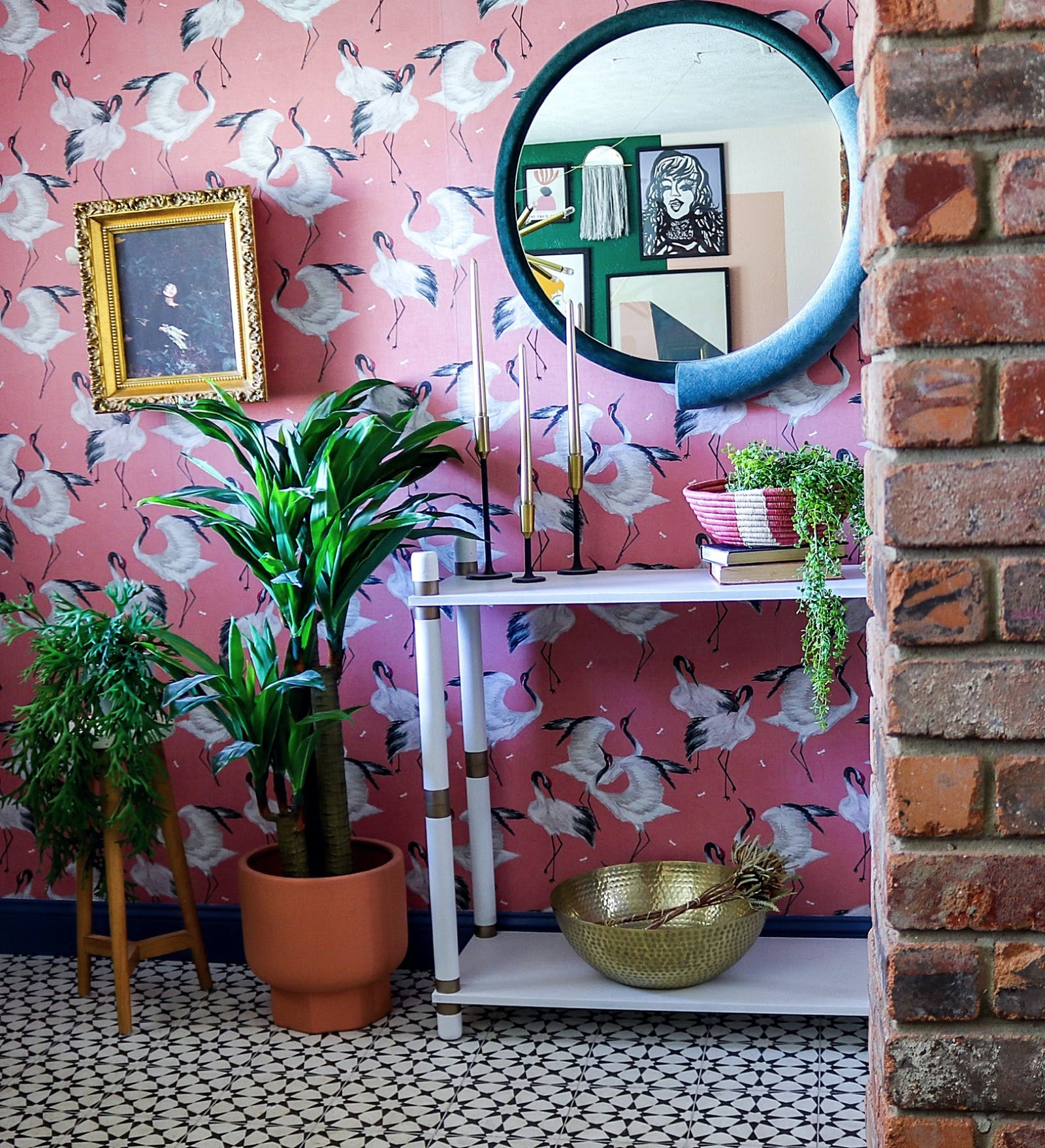Image of hallway with bird print wallpaper and large plants