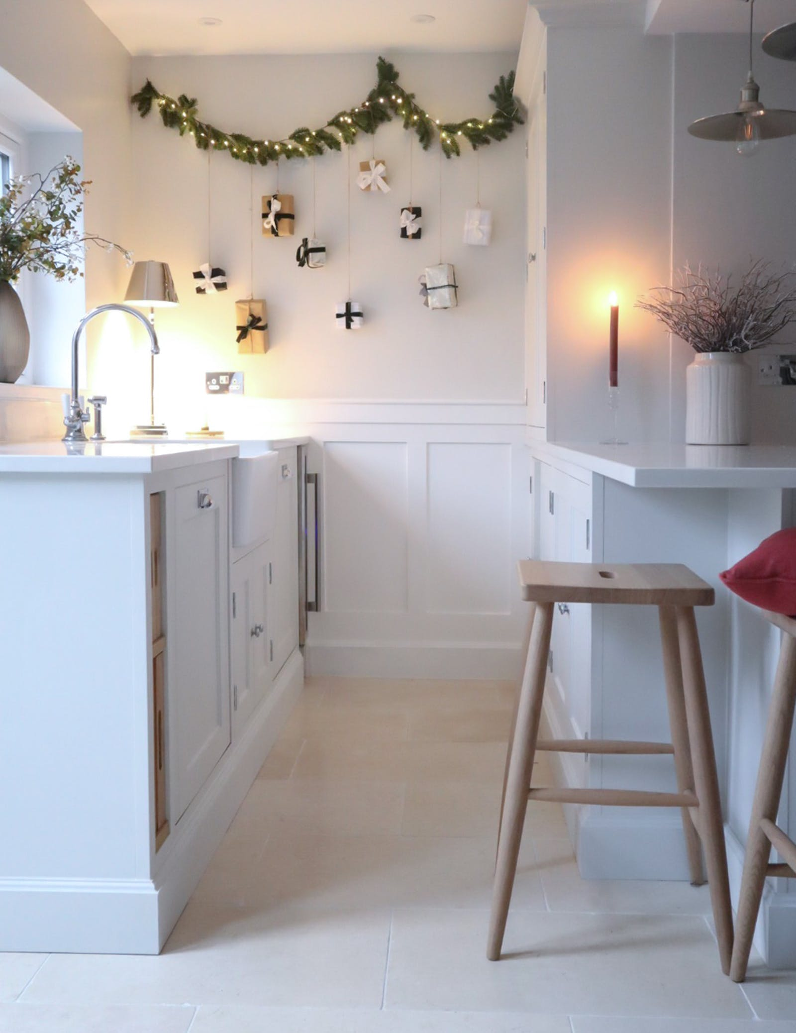 Kitchen decorated in Christmas garlands, presents and lights