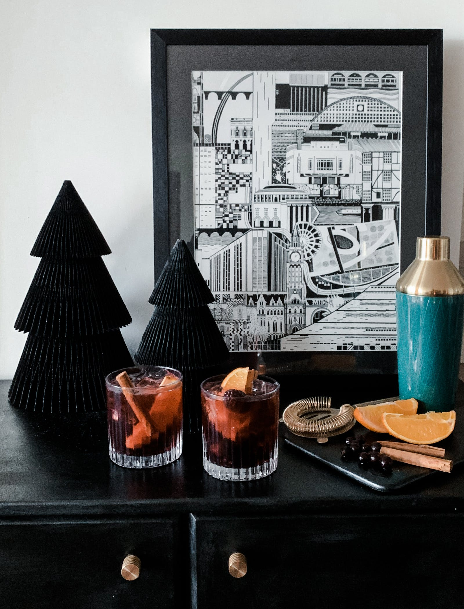Two glasses of mulled wine on a black cabinet