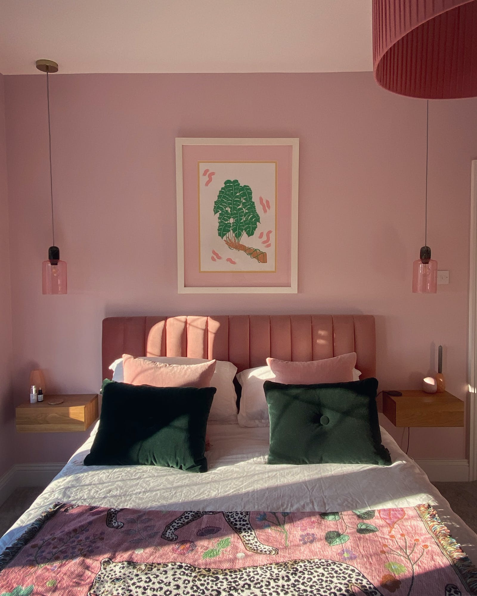 Bedroom painted in Pink 03 with green and pink soft furnishings and hanging lights