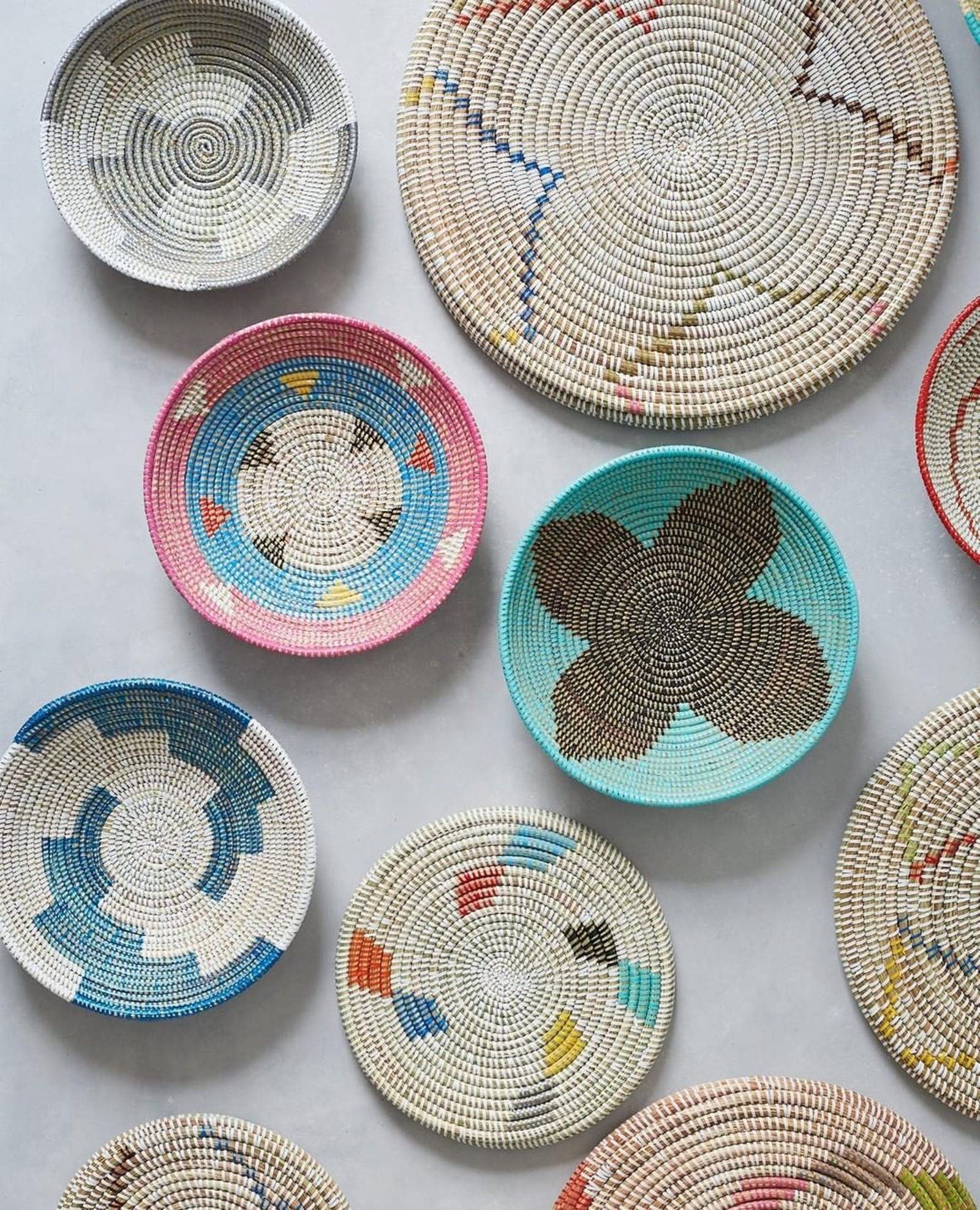 A selection of woven baskets and placemats