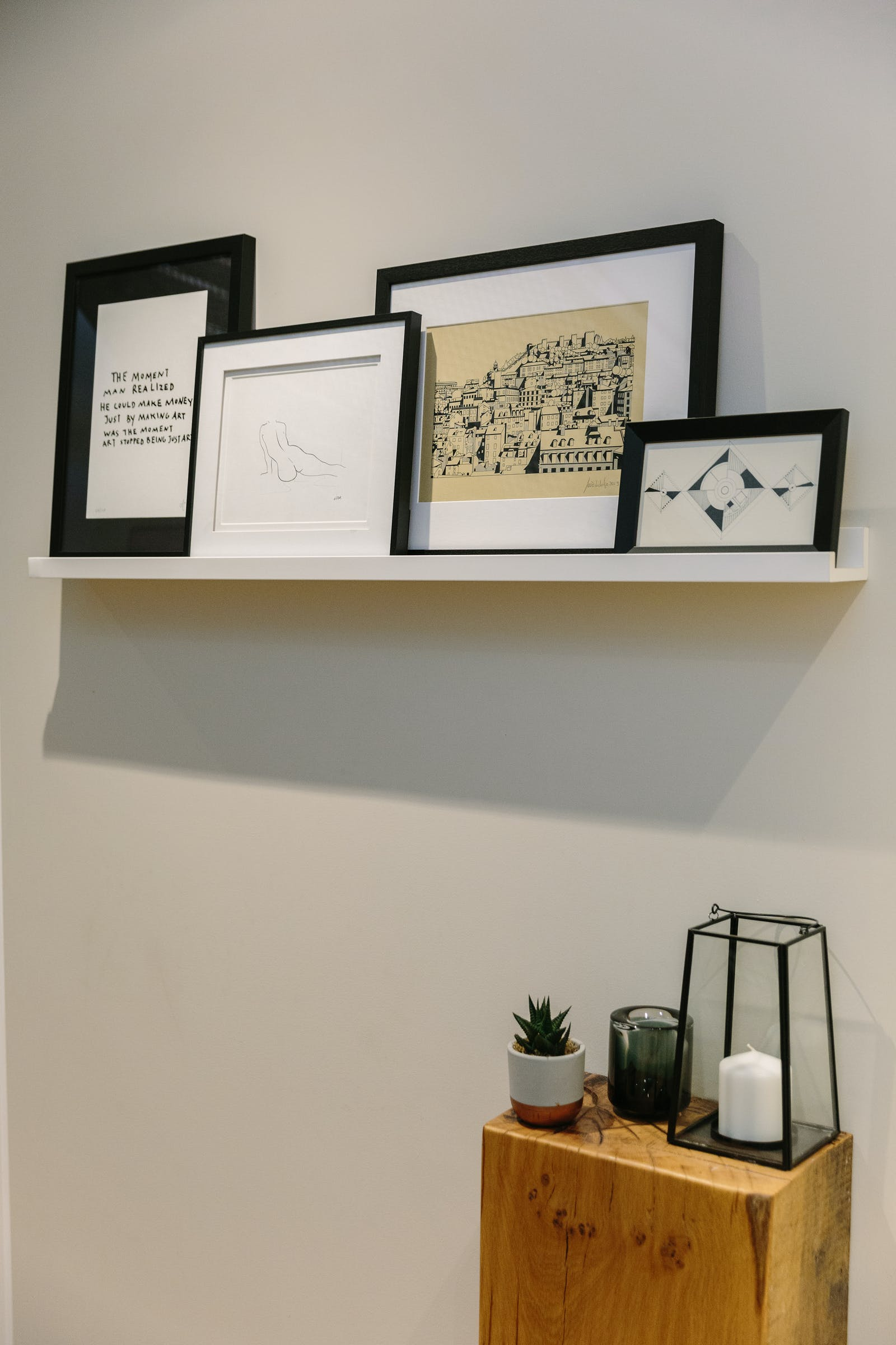 Picture ledge with art work and grey walls