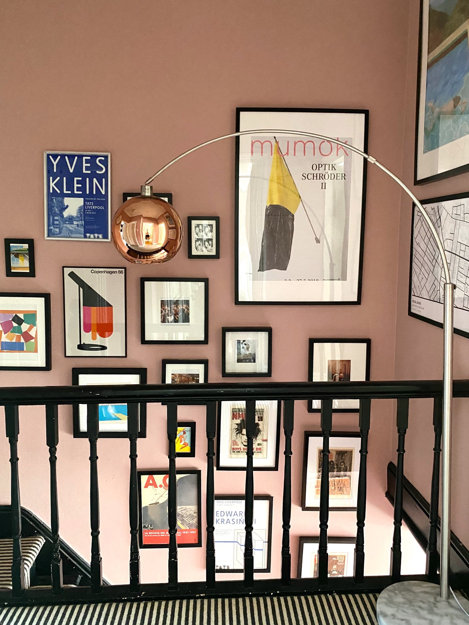 Hallway with a gallery wall painted in a peachy colour