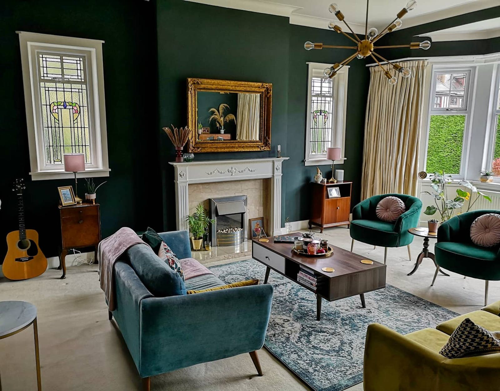 Large living room with green sofas painted in Lick Green 06