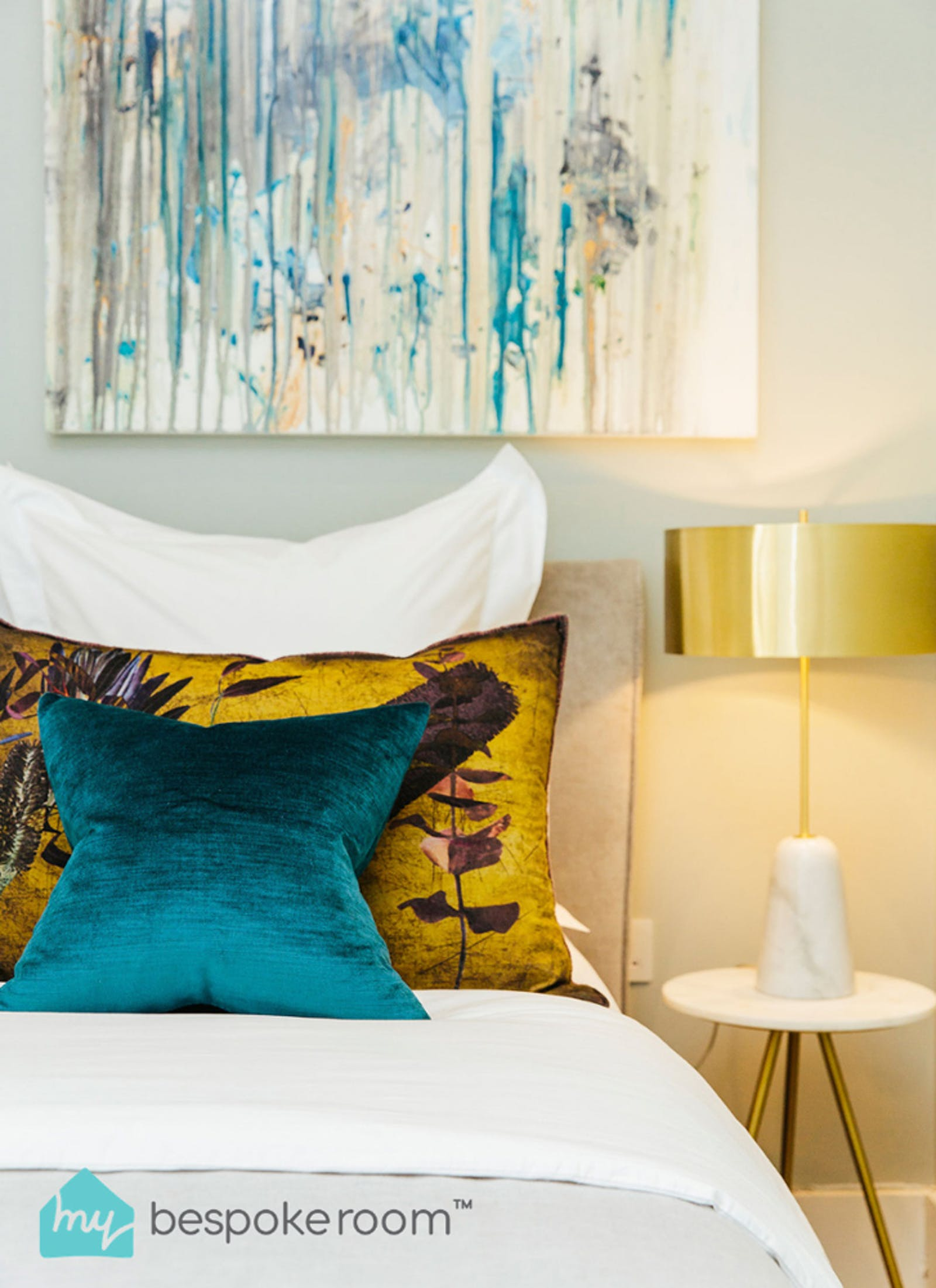 Image of bedroom with yellow and turquoise pillows