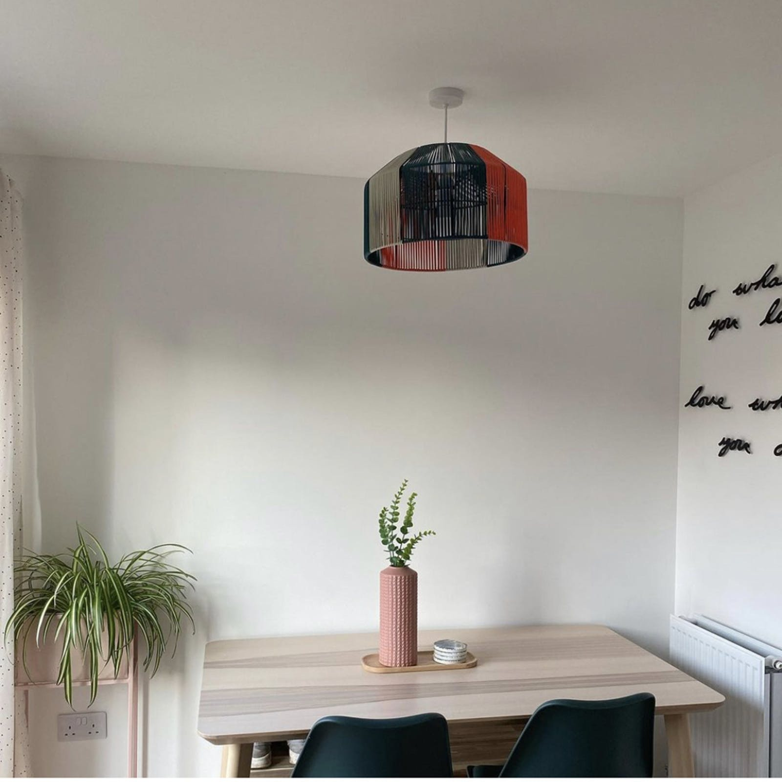 Dining room with white walls and plants