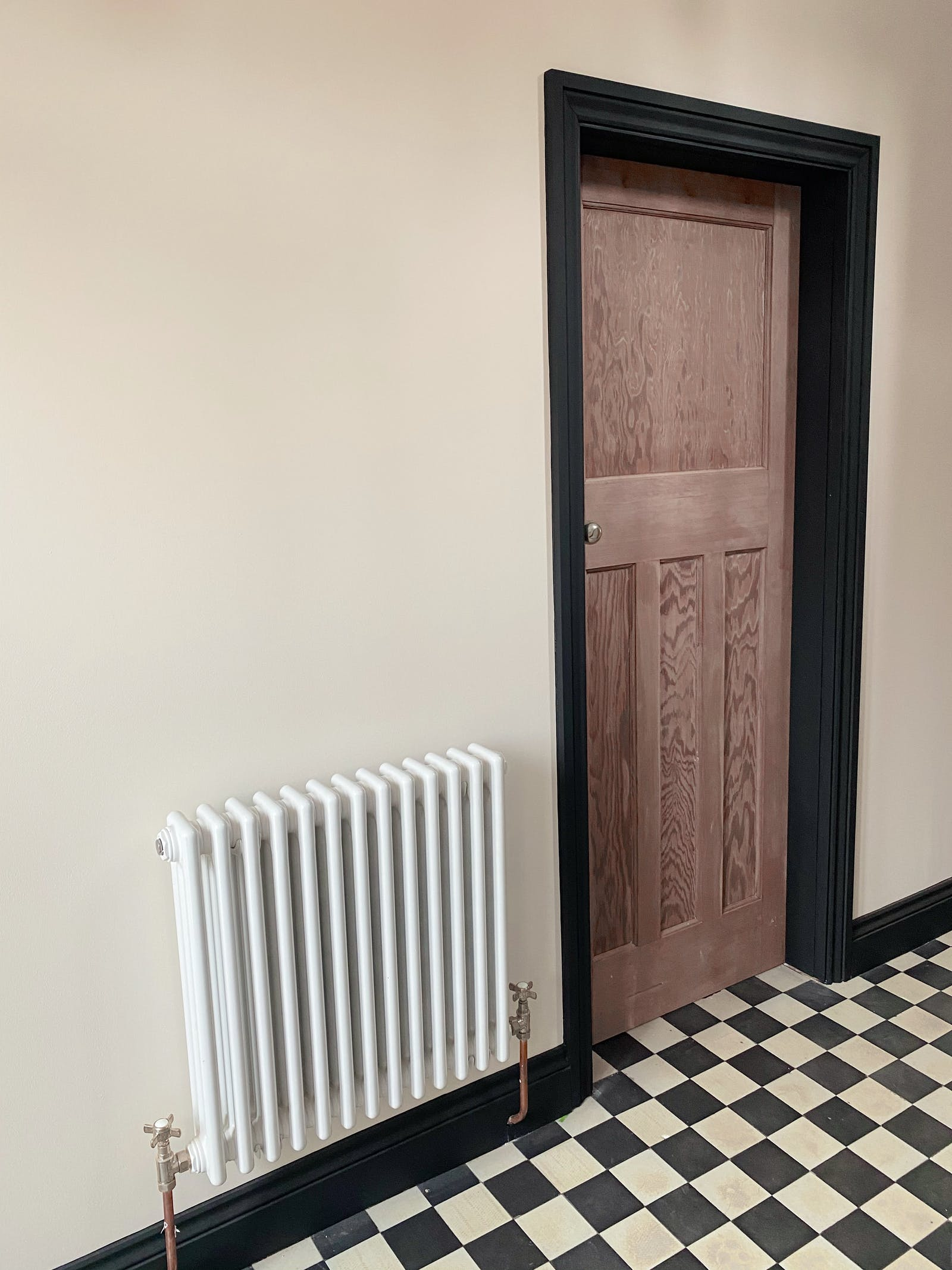 Image of door frame painted in Lick Black 02 with checker-board flooring