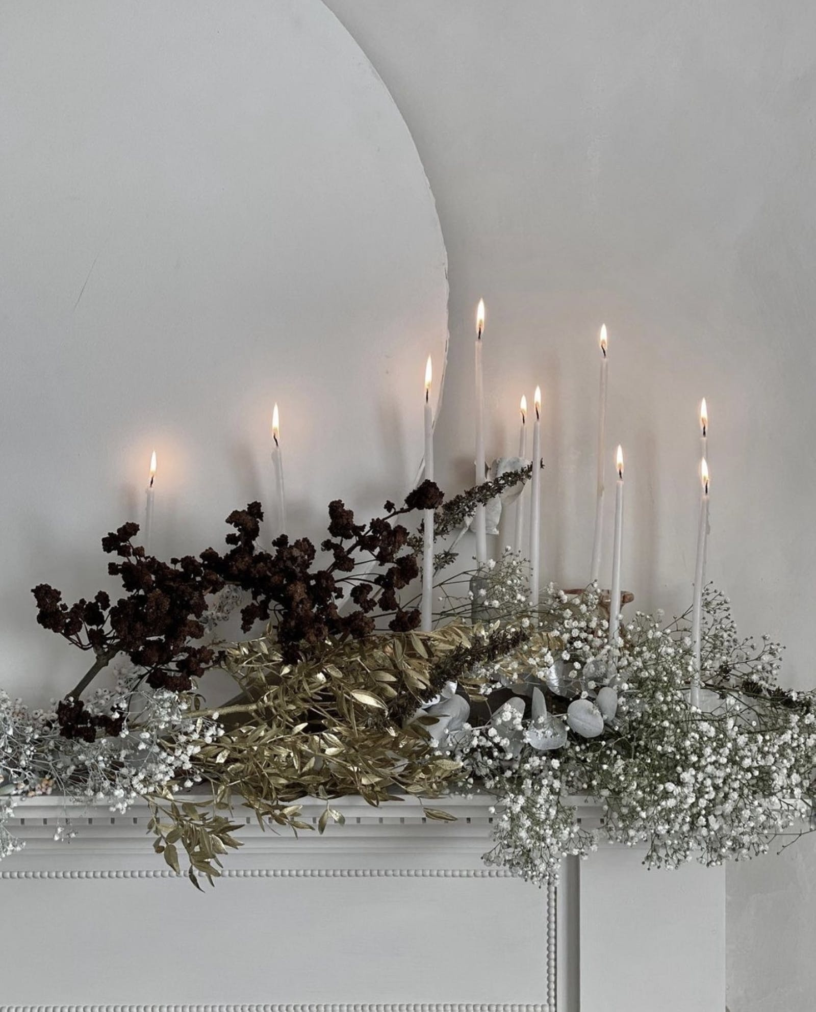 Candles burning in foliage display