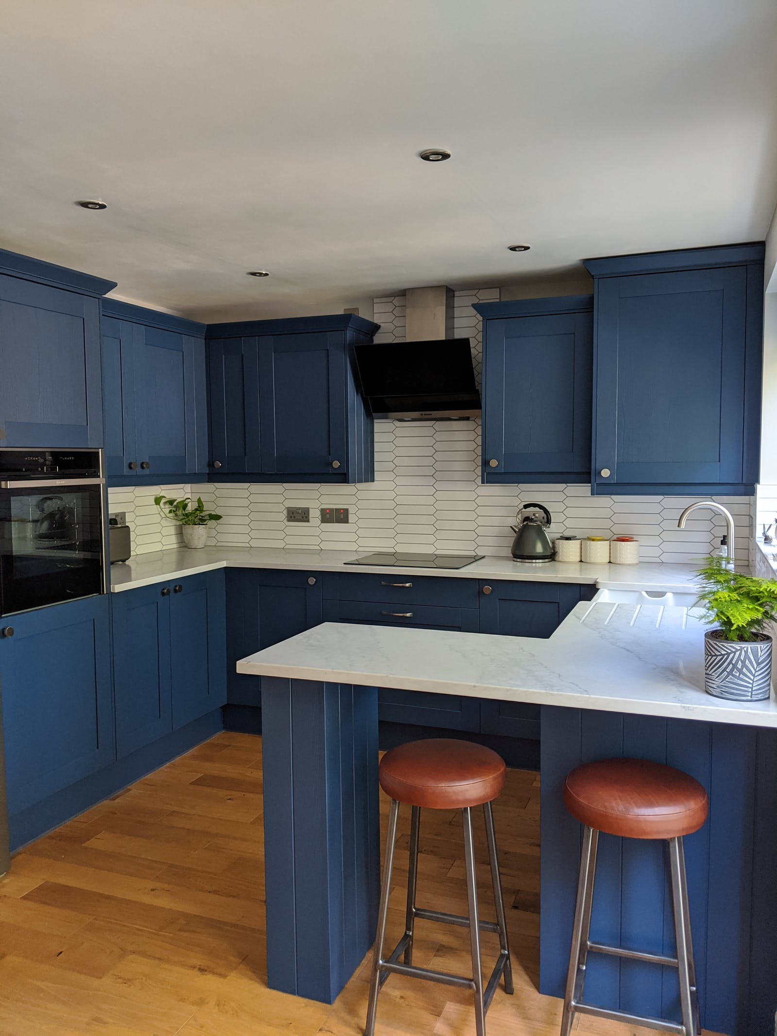 Kitchen cabinets painted in Lick Blue