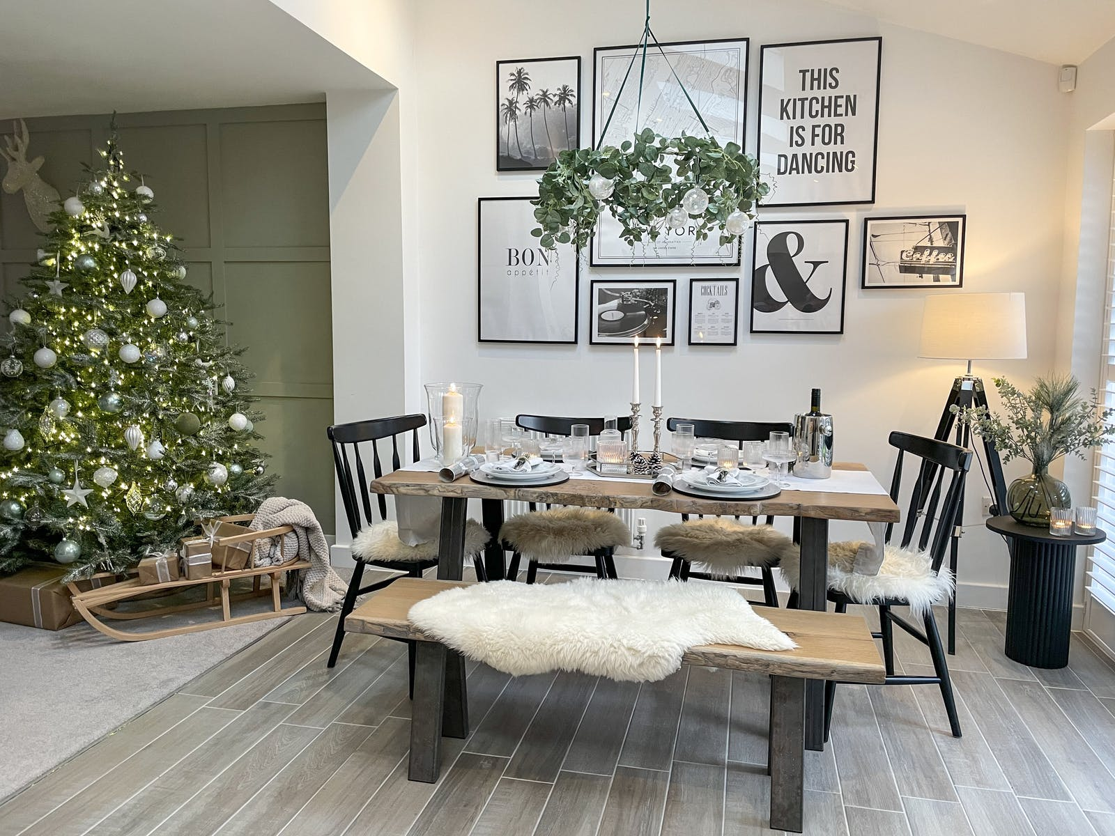 Dining area with large Christmas tree in the background