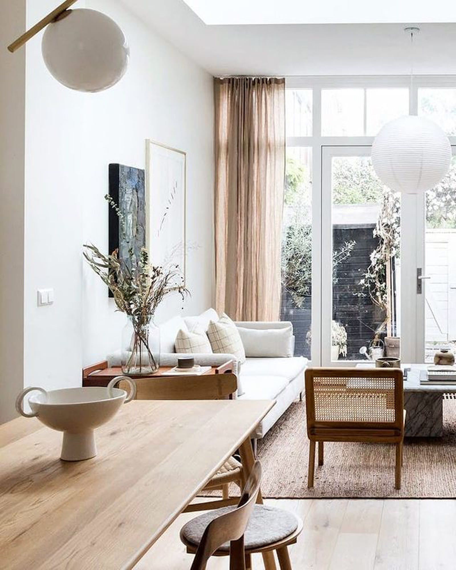 Open-plan kitchen living room decorated in neutral colours, in a Japandi interior style