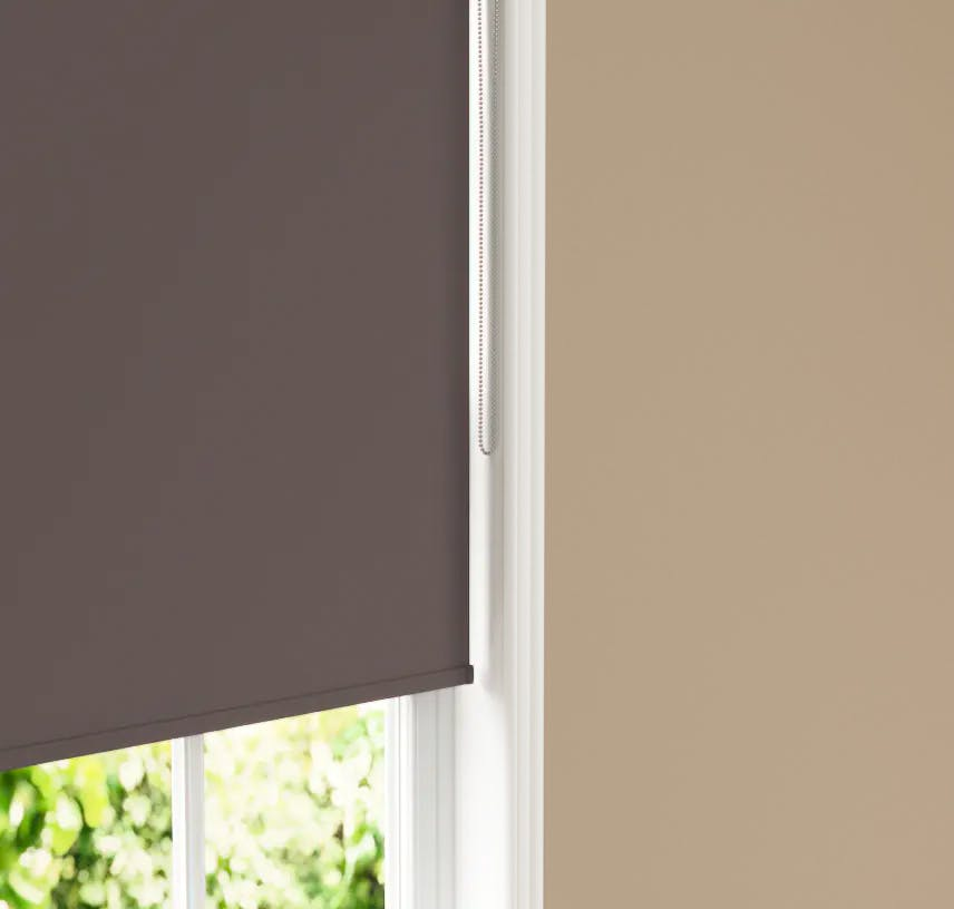 Close up of Lick Brown 01 roller blind against Beige 02 wall