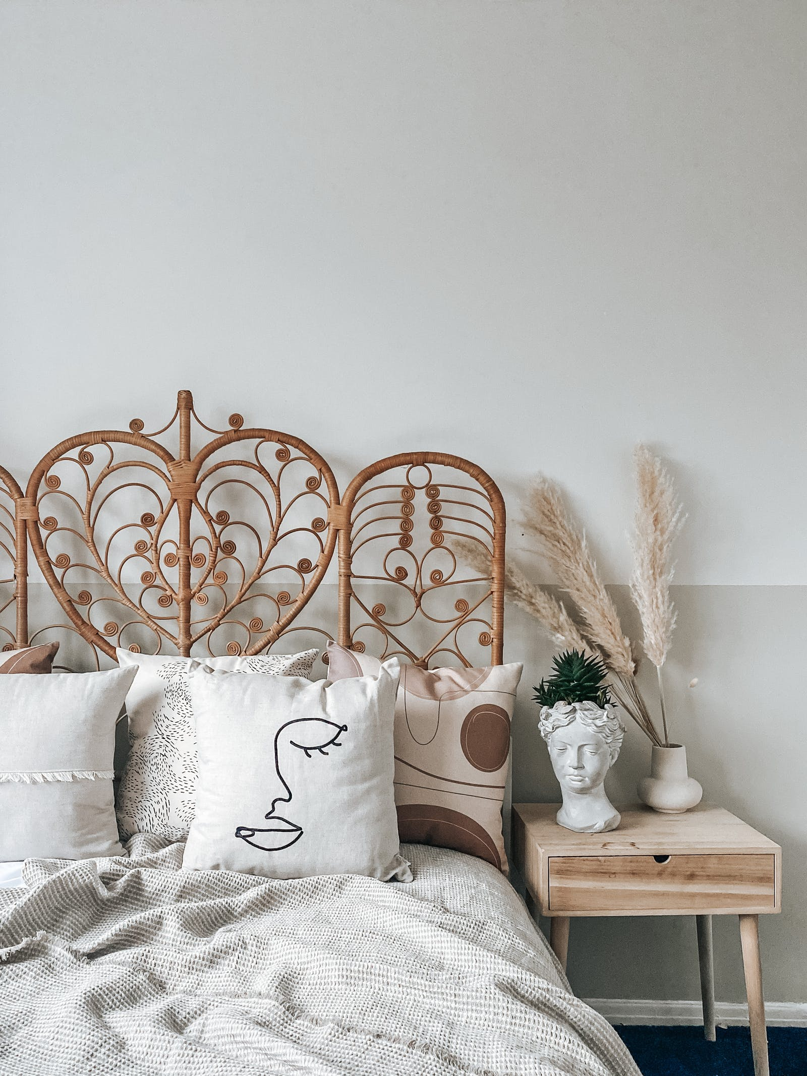 Bedroom Painted in two tone Lick Beige 01 and White 05 with cushions and rattan headboard