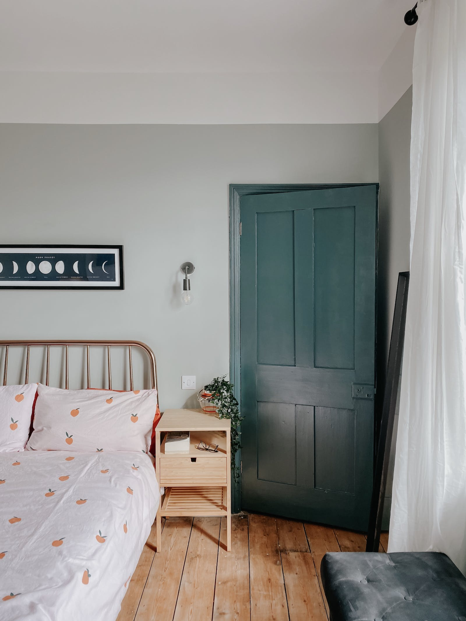Mint colour bedroom walls and teal coloured bedroom door