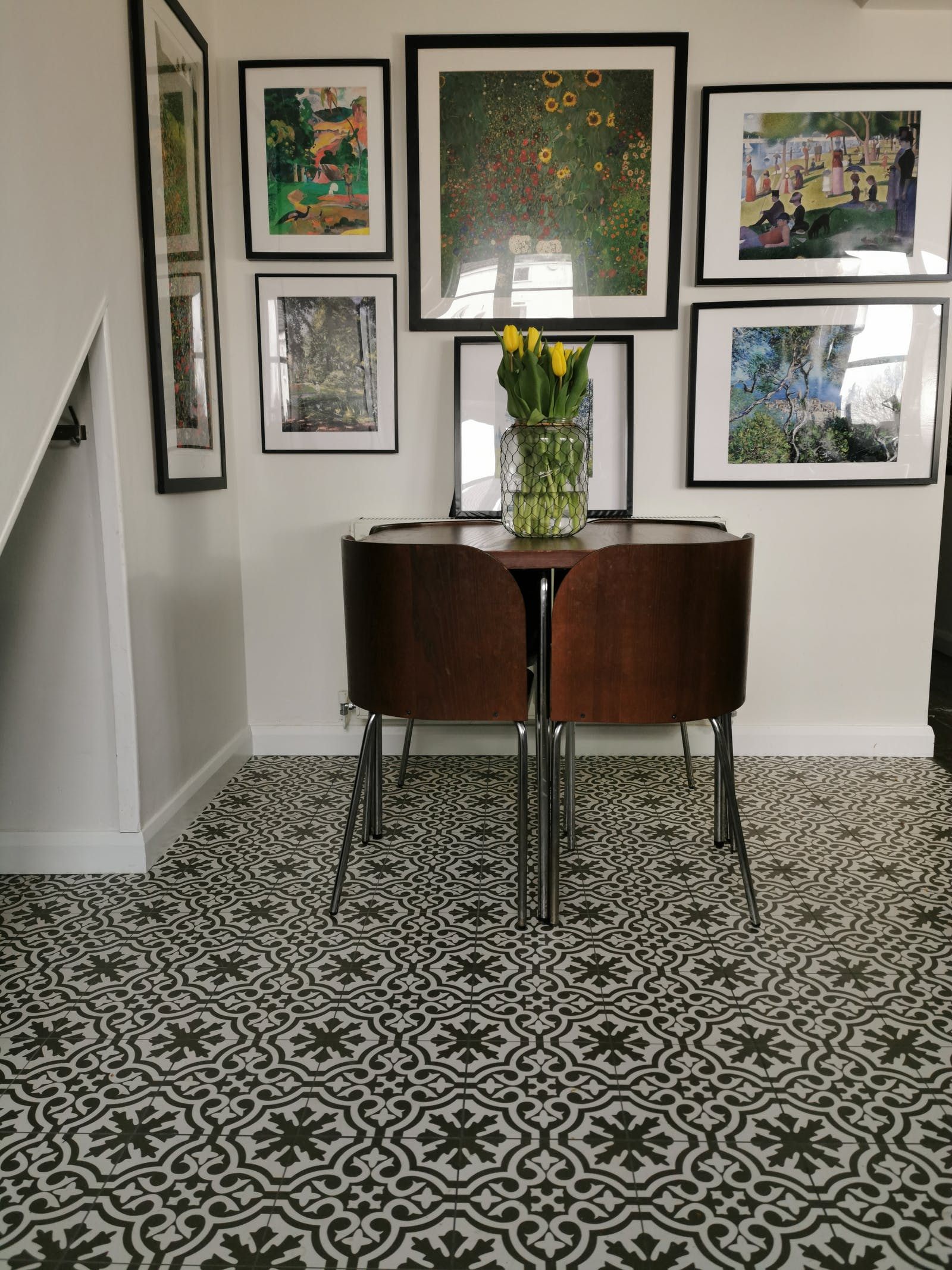 hallway with patterned carpet and a vintage wooden table
