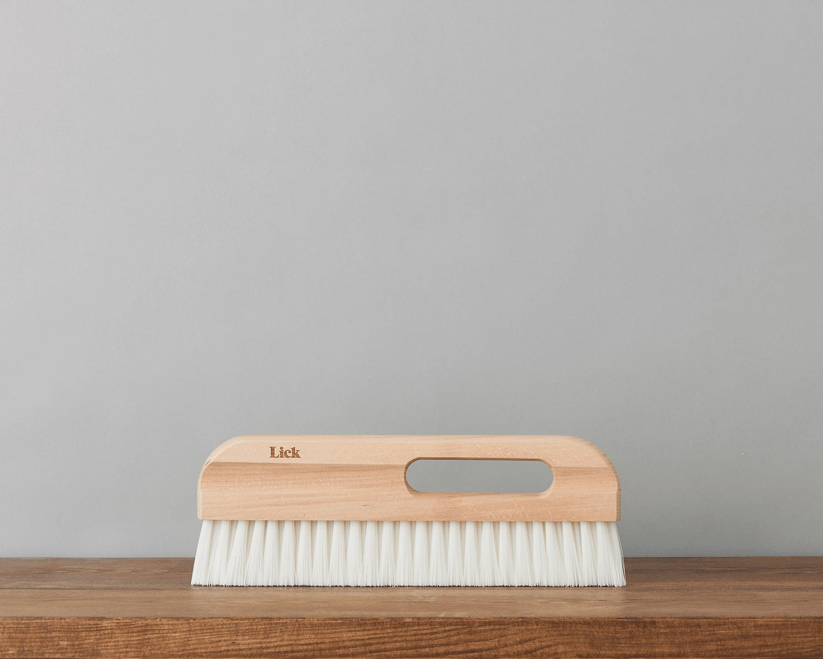 An image of the Lick wallpaper brush eco supplies against a grey background