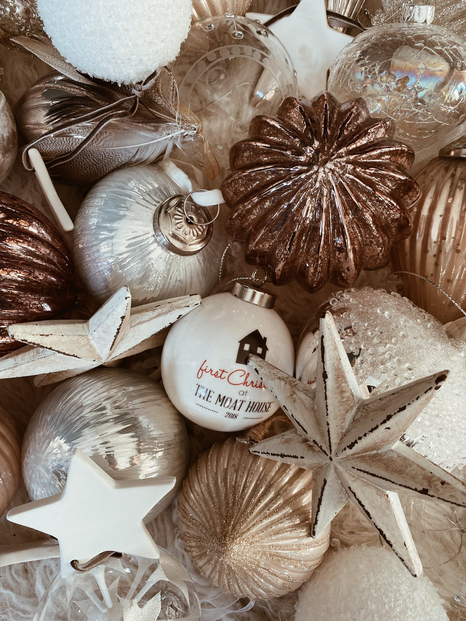 An assortment of bronze and white baubles