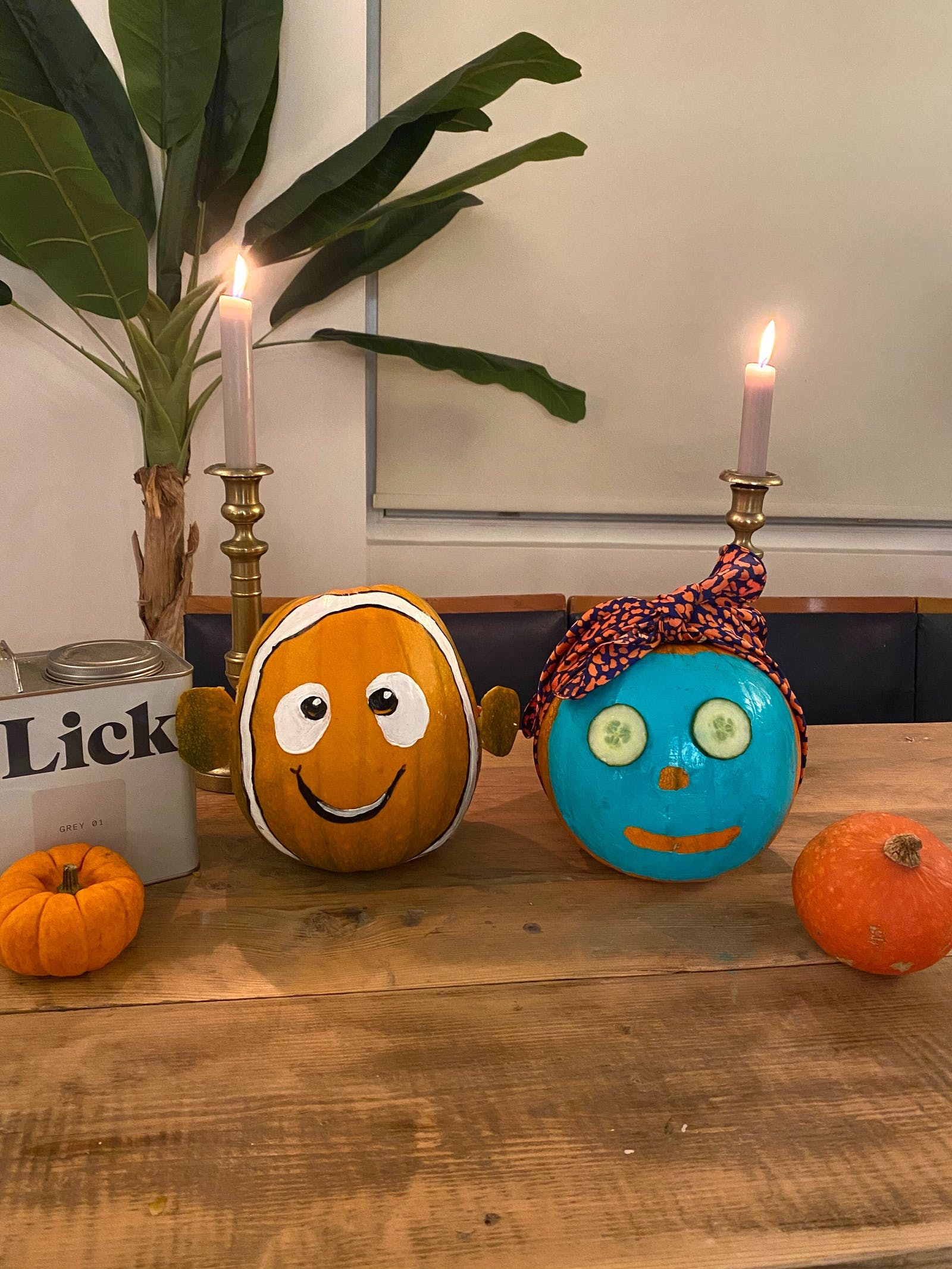 Pumpkins painted as Nemo or a face with cucumbers