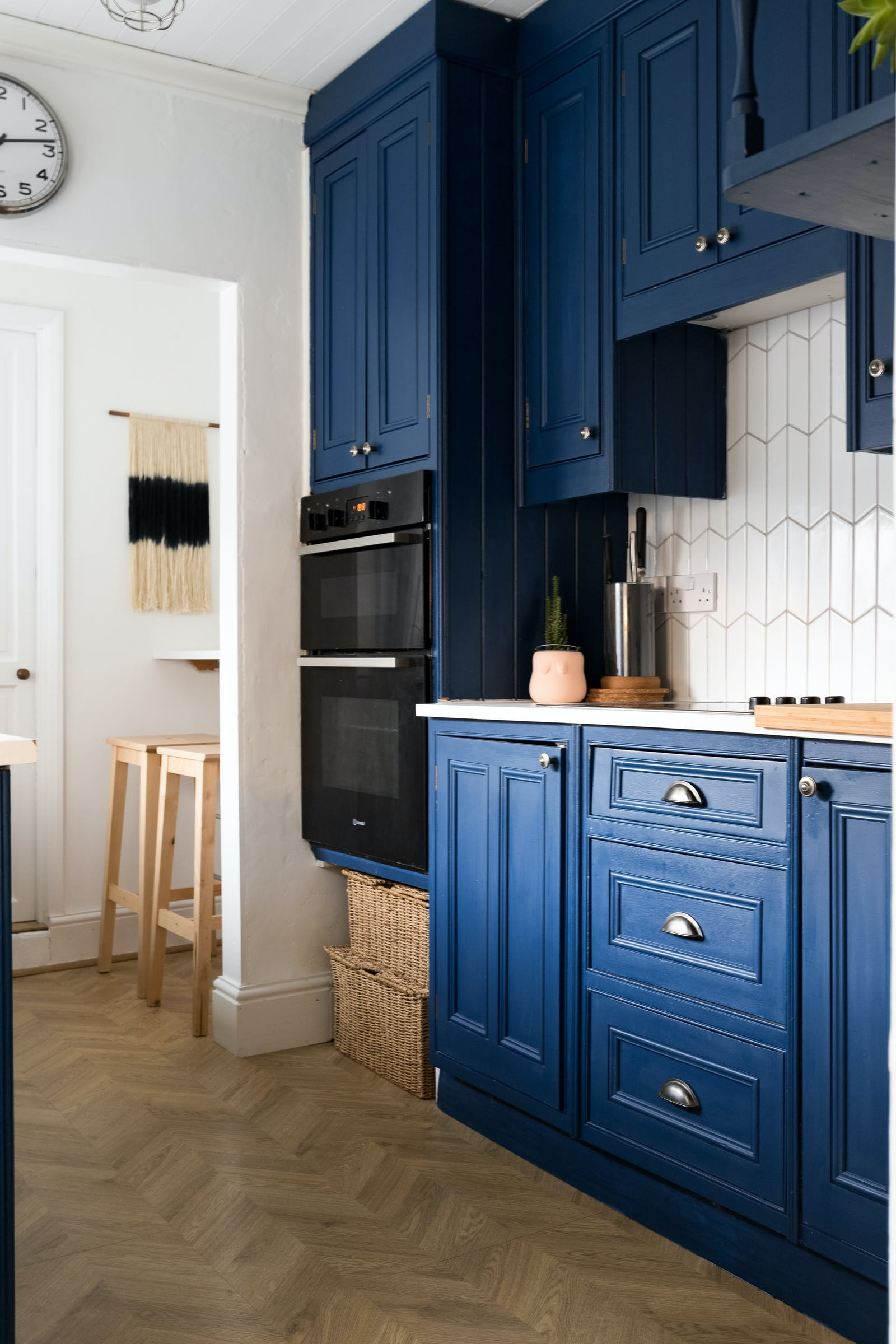 Kitchen cupboards painted in a navy blue