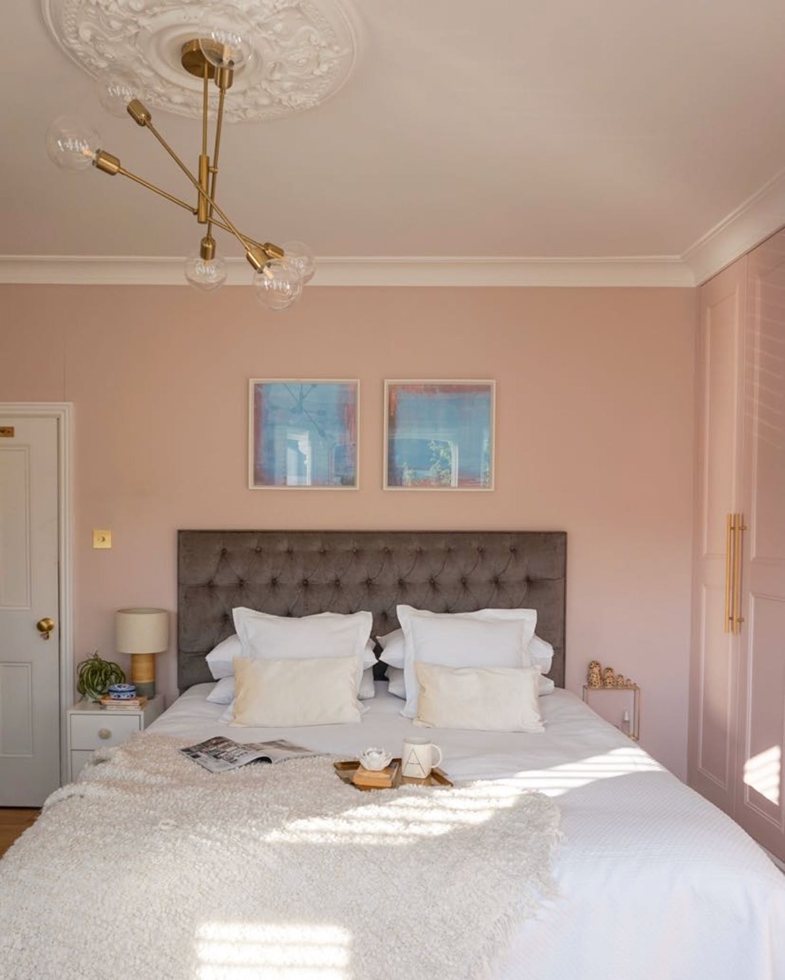 Spacious master bedroom painted in pink