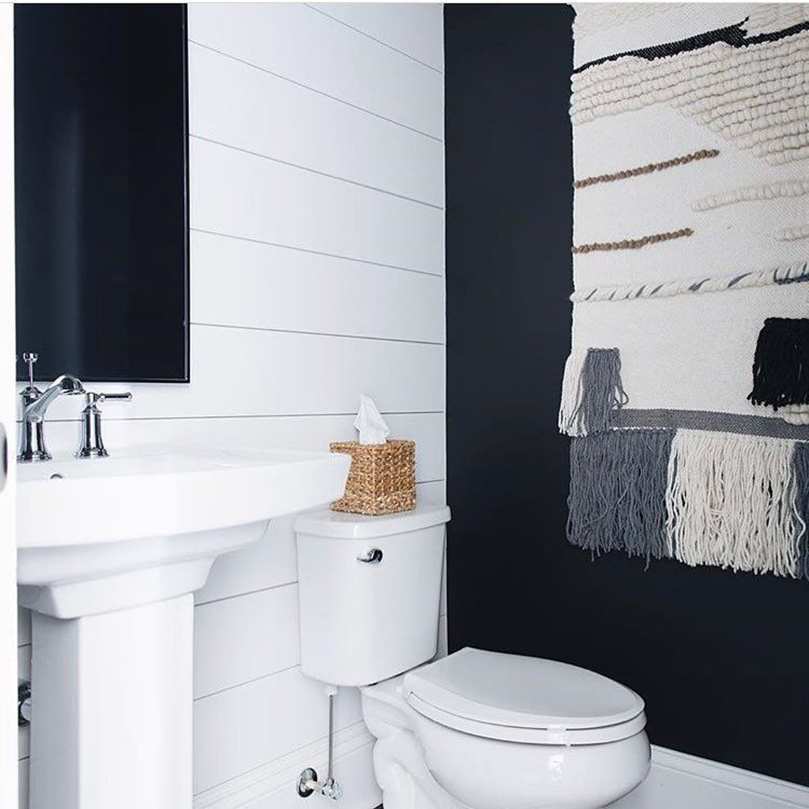 Black and white bathroom with textures on the wall