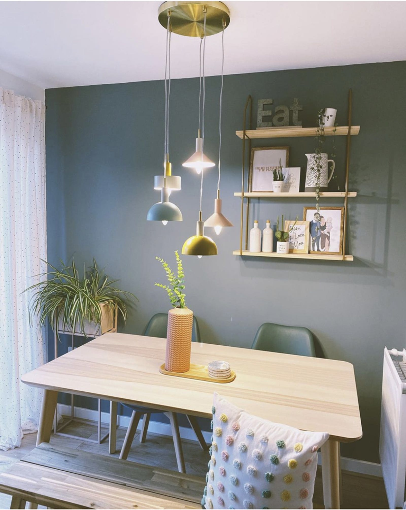 Dining room painted in a Teal shade