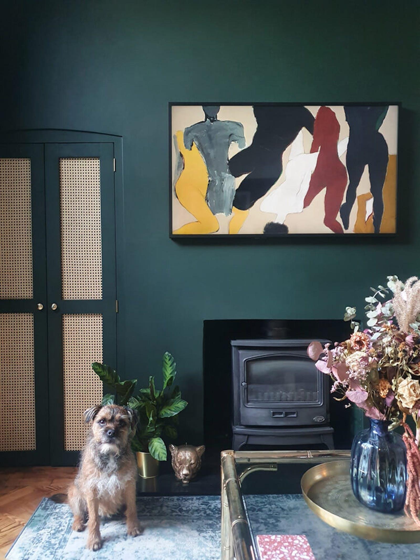 Living room dark green walls and stylish artwork