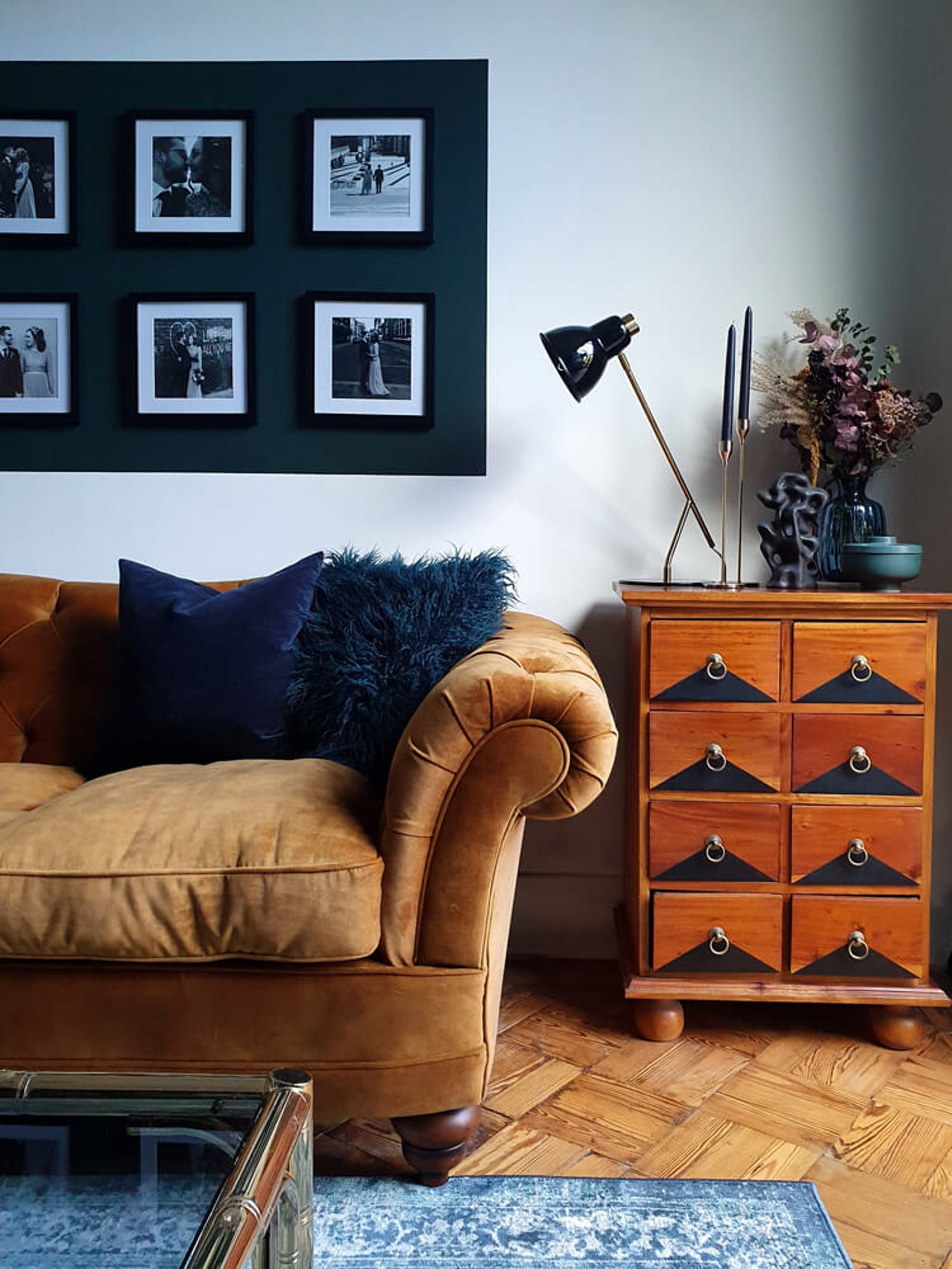 Living room with a dark mustard velvet sofa
