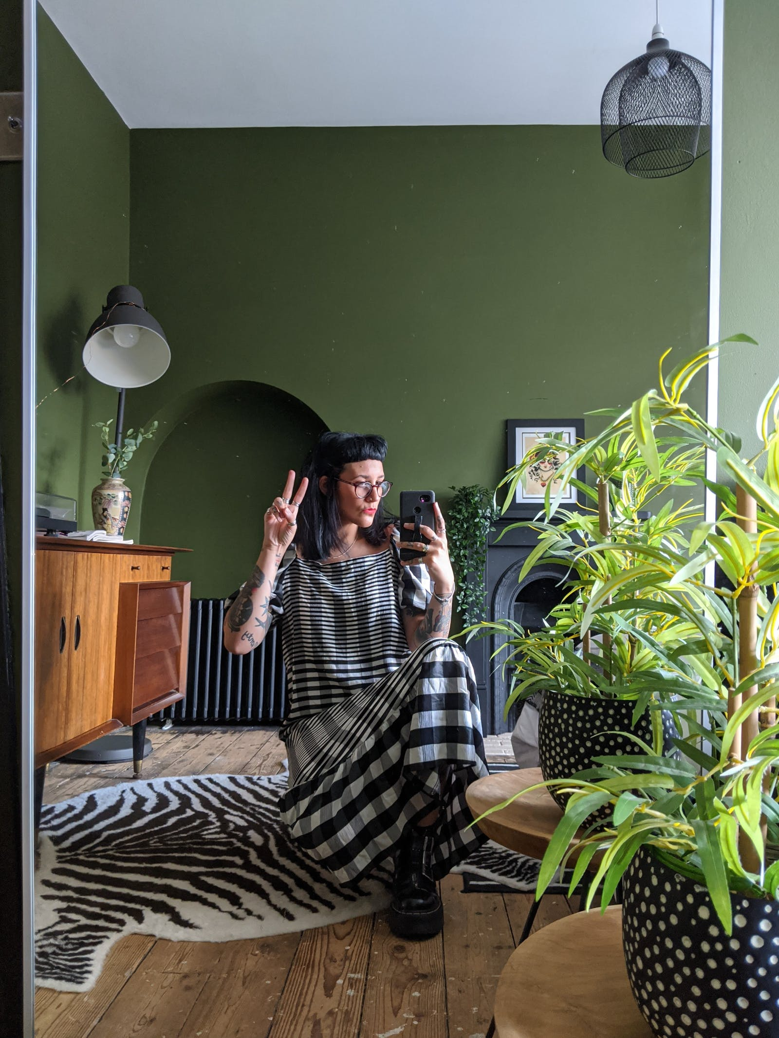 Rachel from @ourgreyhaven posing in her new bedroom painted in Lick Green 05, a beautiful forest green