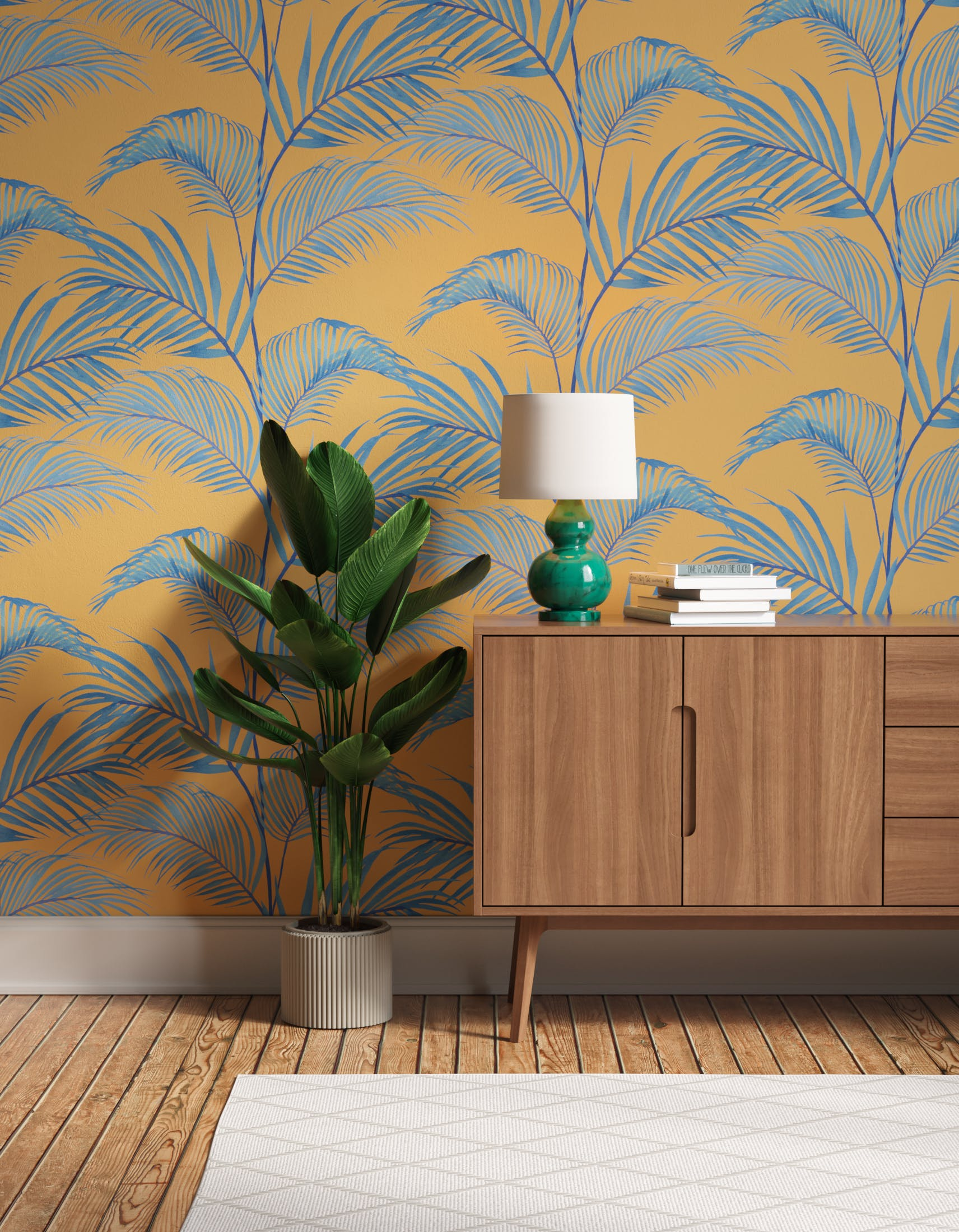 Hallway with yellow and blue Jungle 01 wallpaper, a large house plant, cabinet and green lamp.
