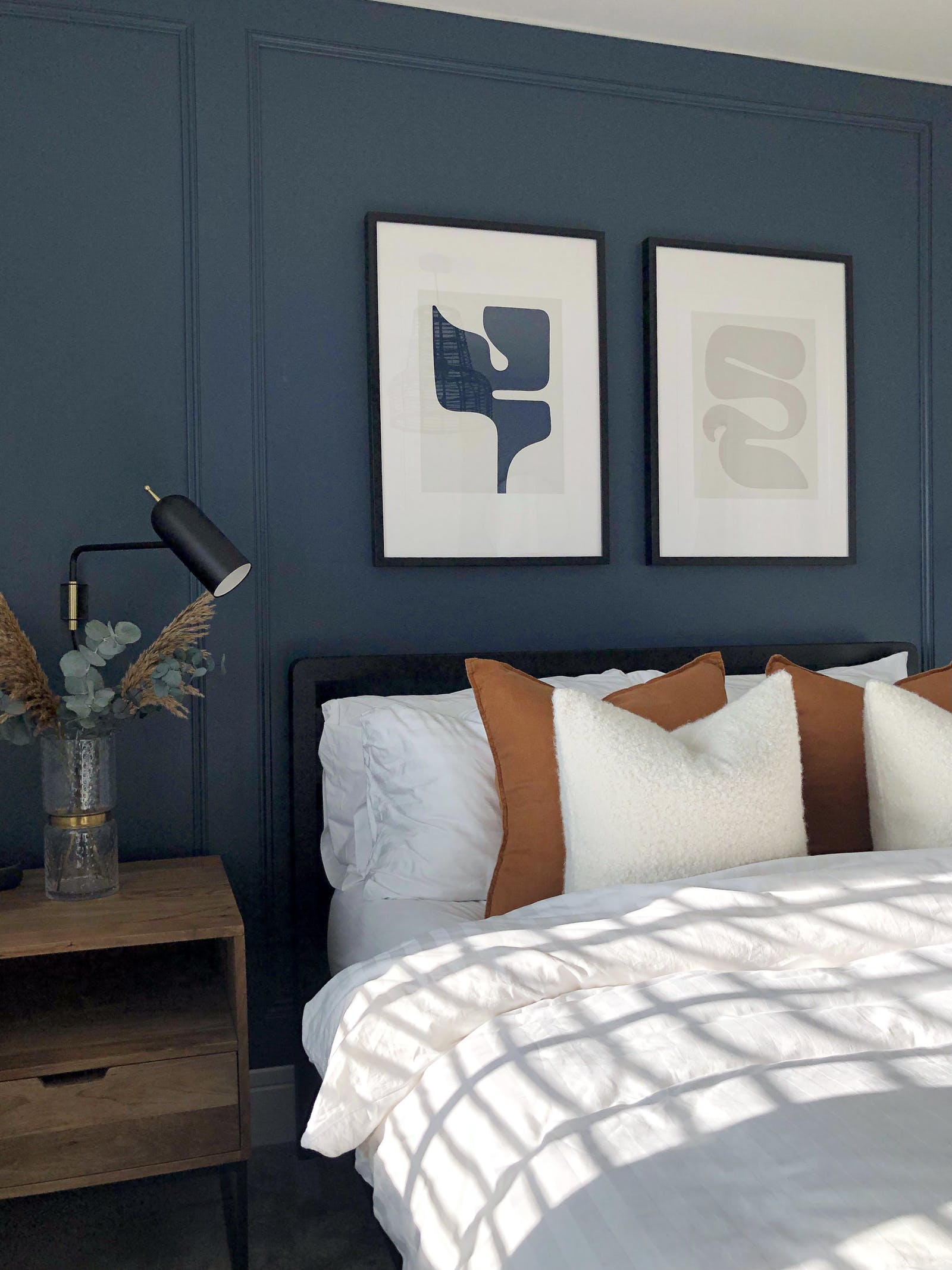 Scandinavian inspired bedroom with dark blue wall panelling