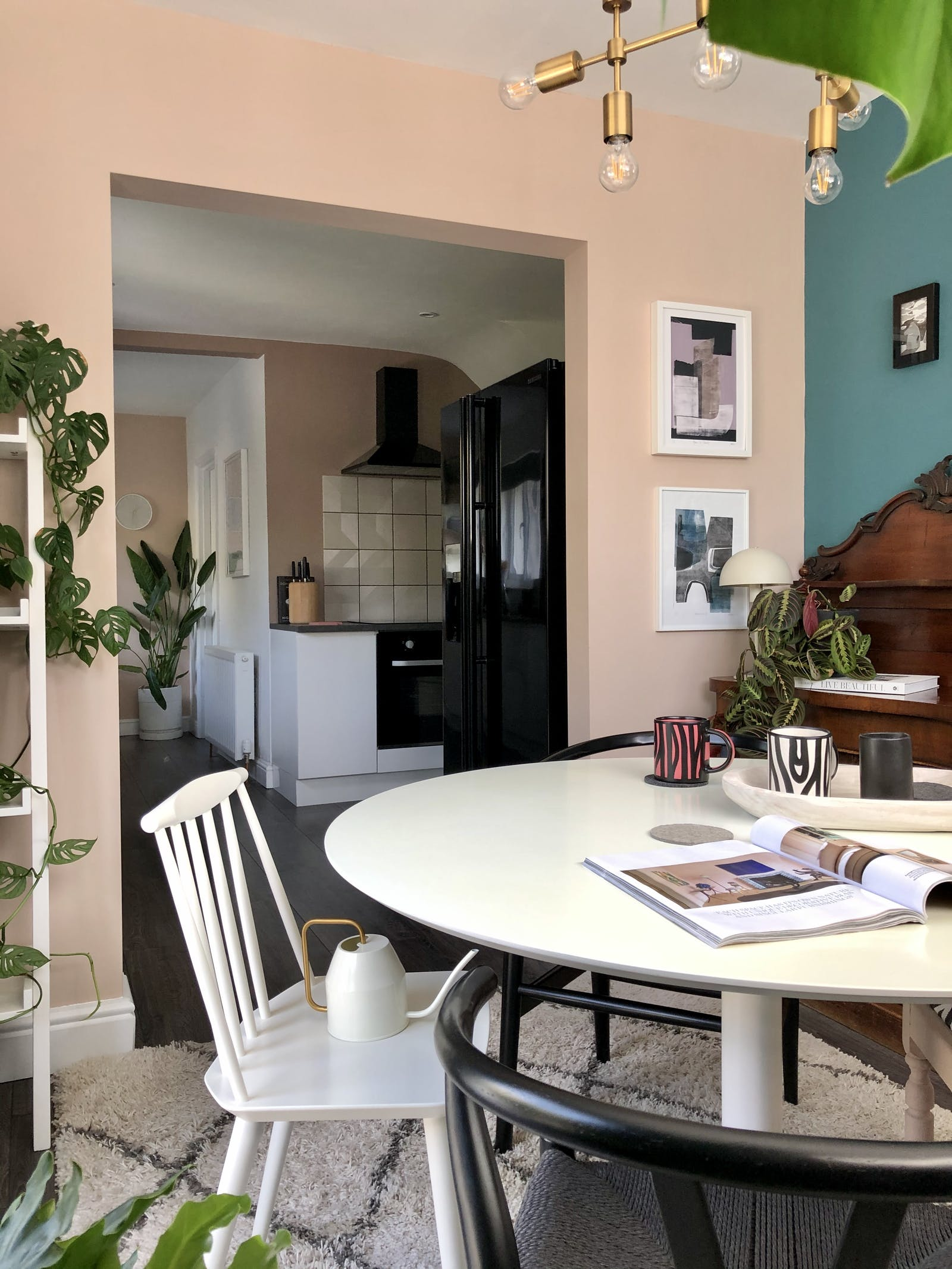 Dining room with turquoise and rose pink walls