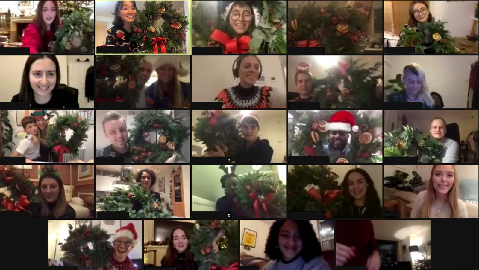 Team Lick group photo with everyone holding their homemade wreaths