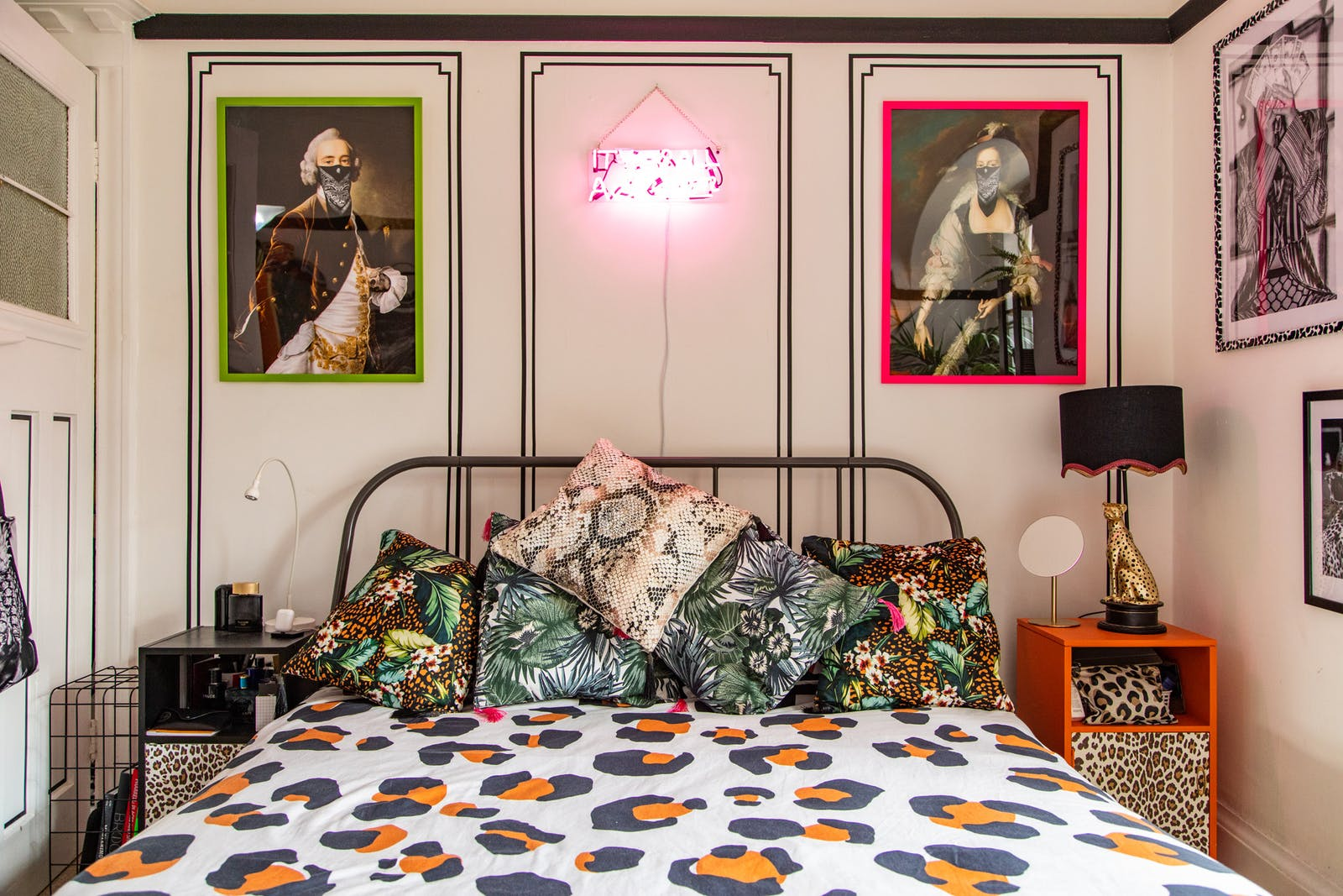 RHOI bedroom with neon light and animal print bed covers and side tables