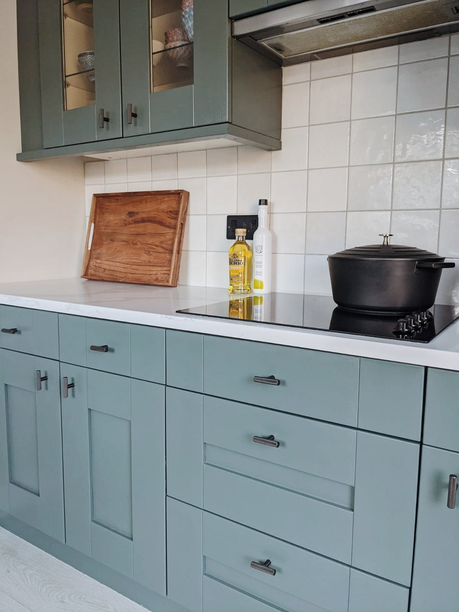 Close up of kitchen cupboards painted in Lick Green 03