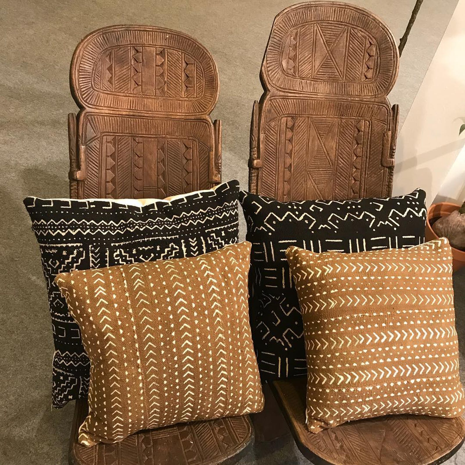 Mud cloth cushions on African style chair