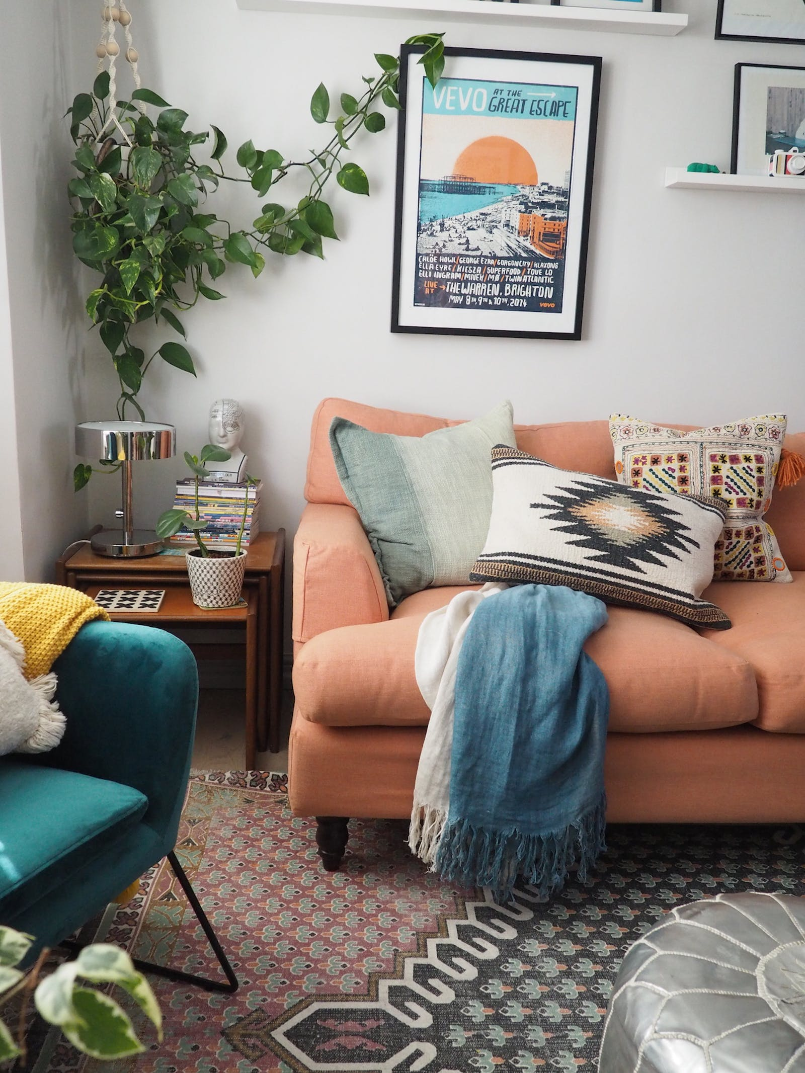 Living room with peach coloured sofa and eclectic cushions