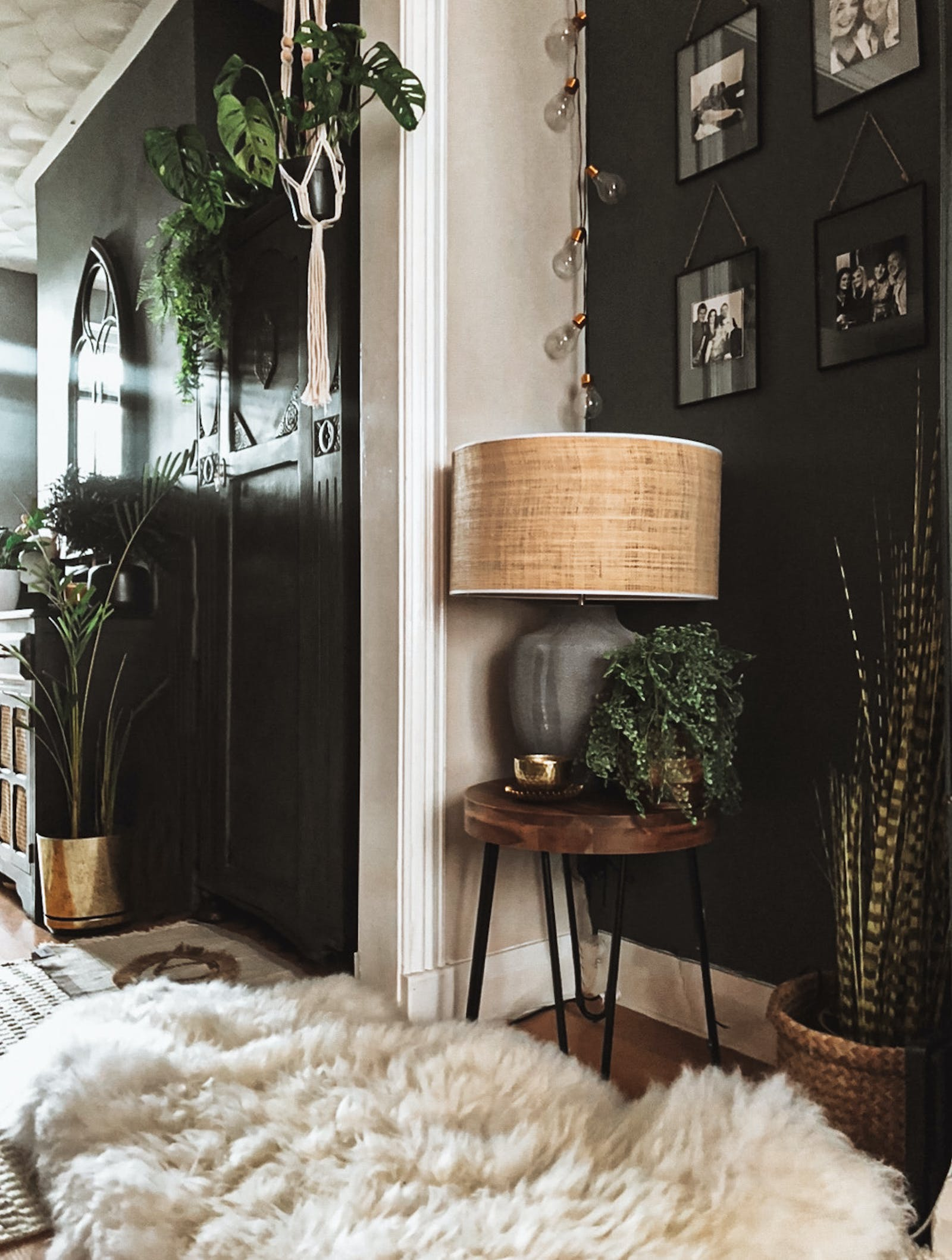 Hallway corner with black wall and a fuzzy rug