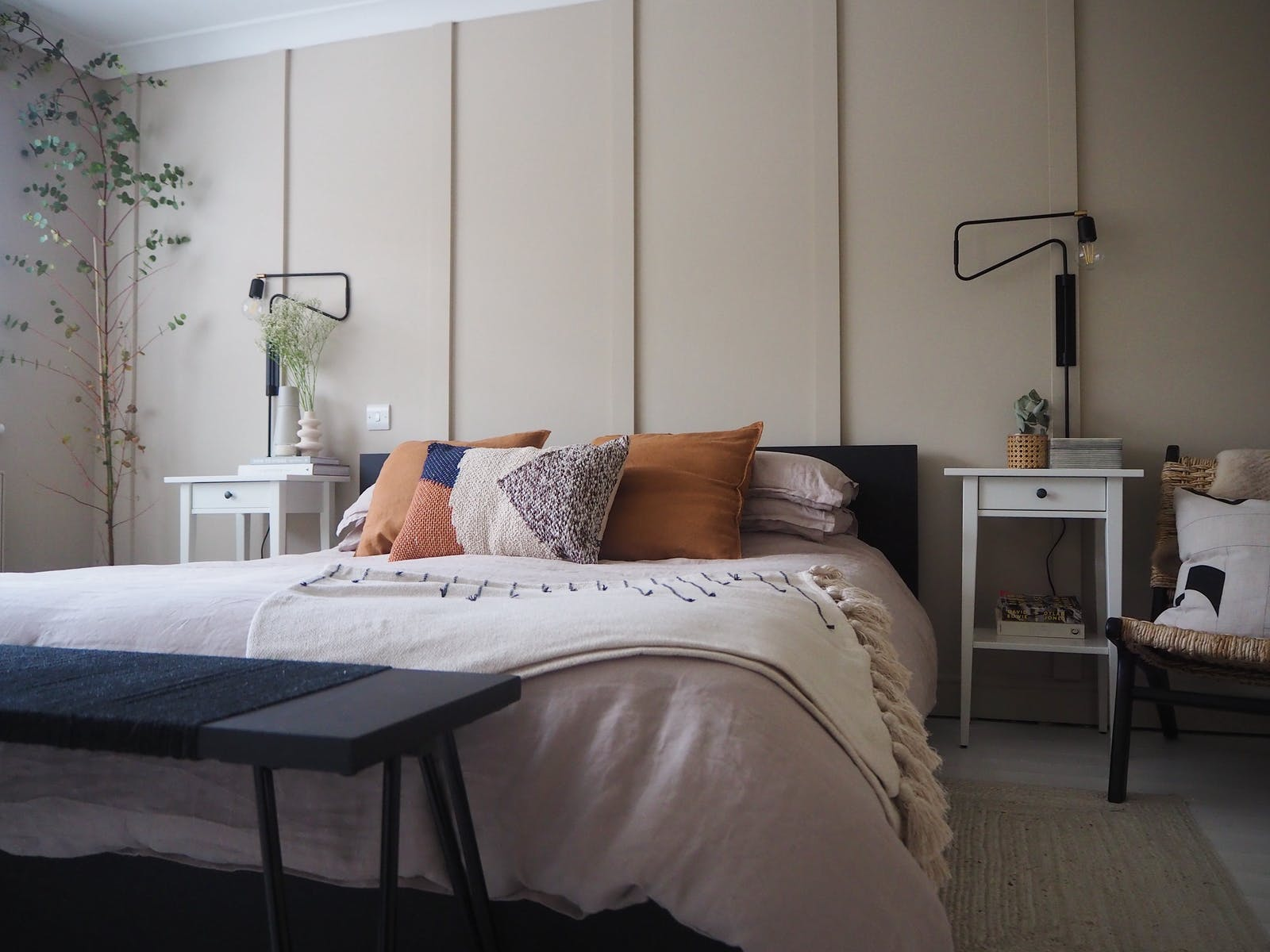 Bright and spacious bedroom with beige panelling